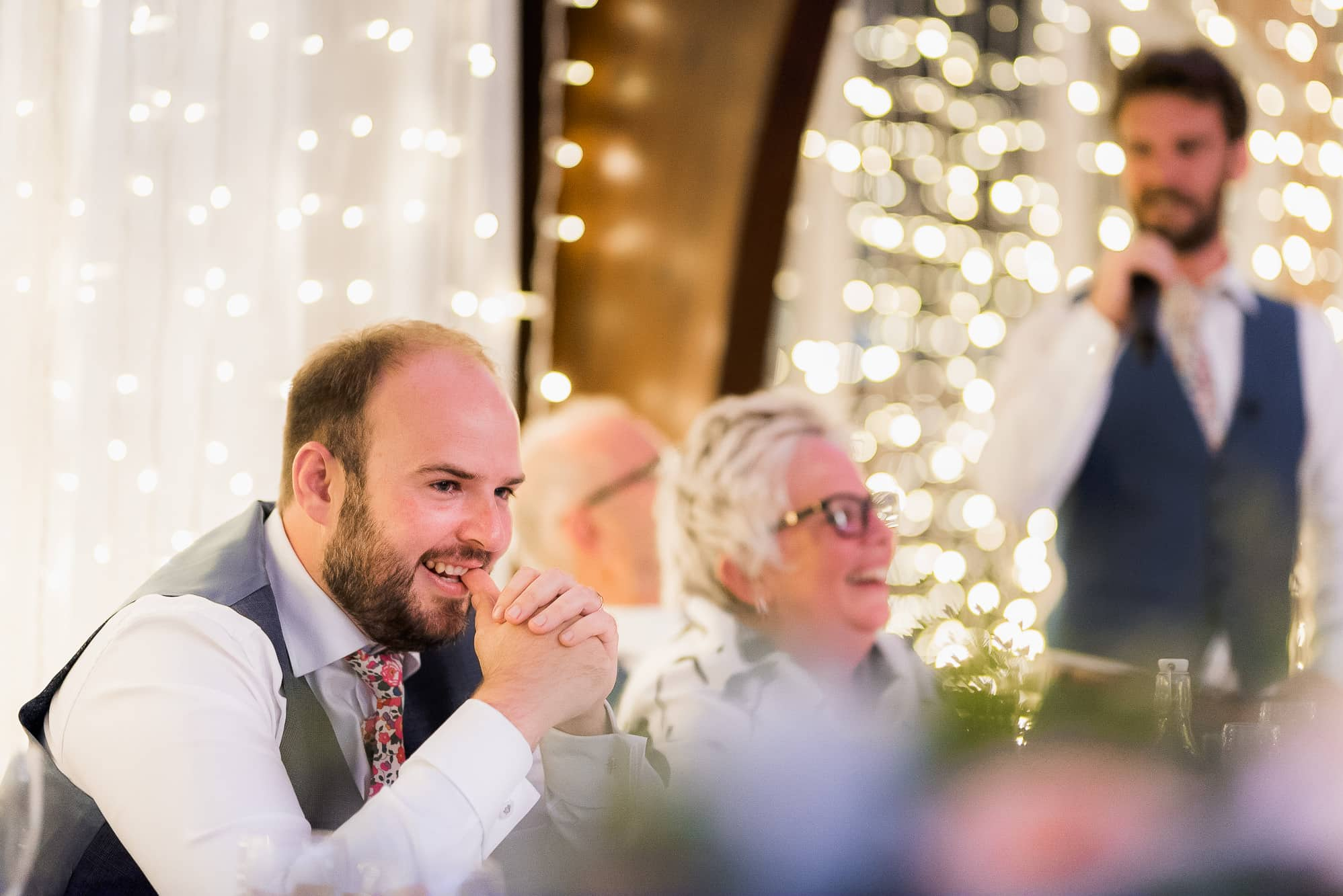 Groom looking on during speeches at Colshaw Hall