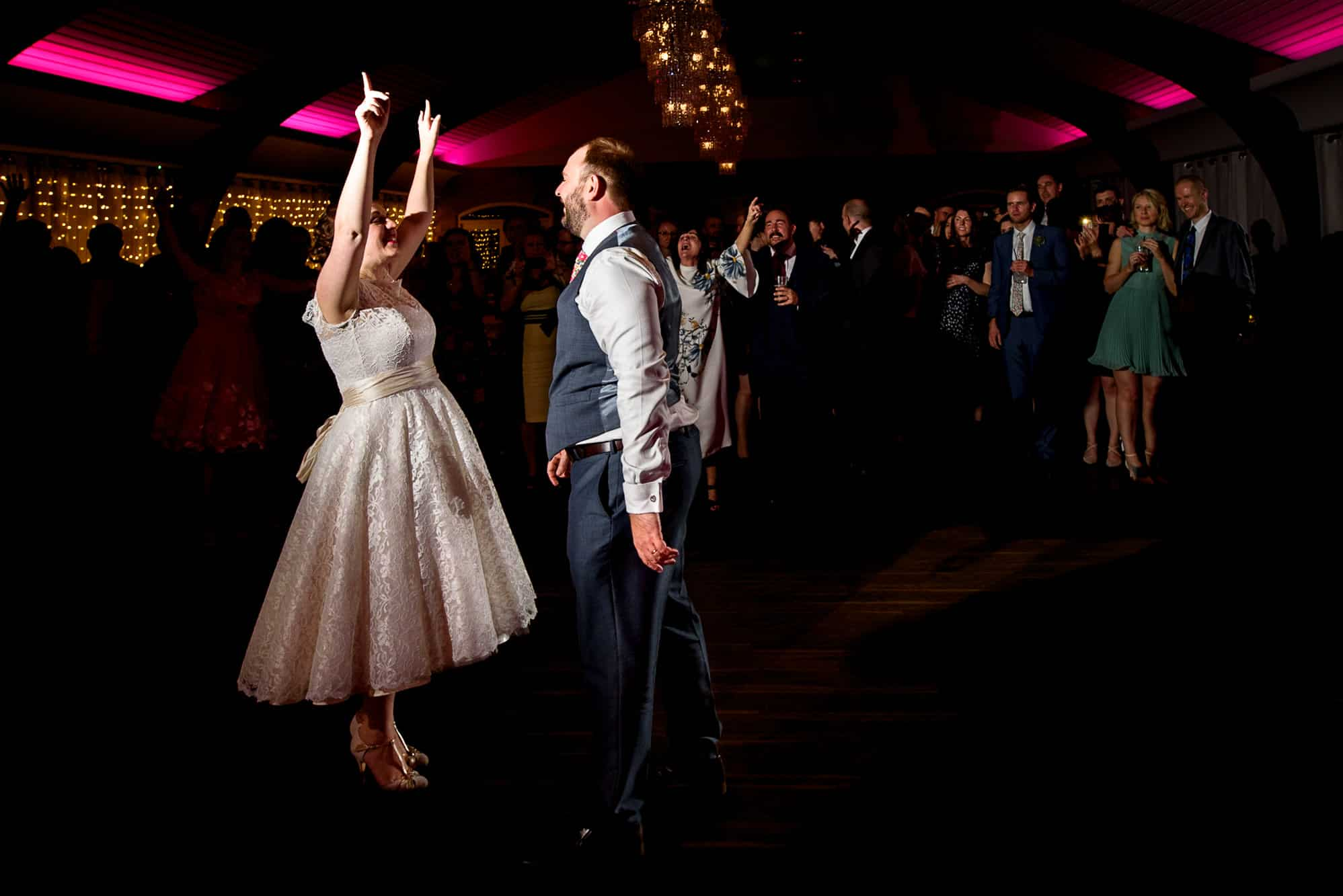 Bride laughing during dance at Colshaw Hall