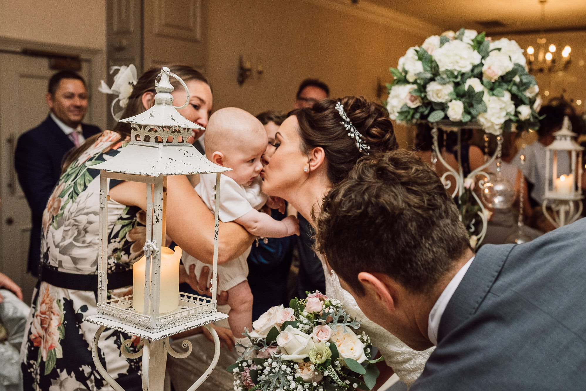 Bride stops to kiss her son at Mottram Hall