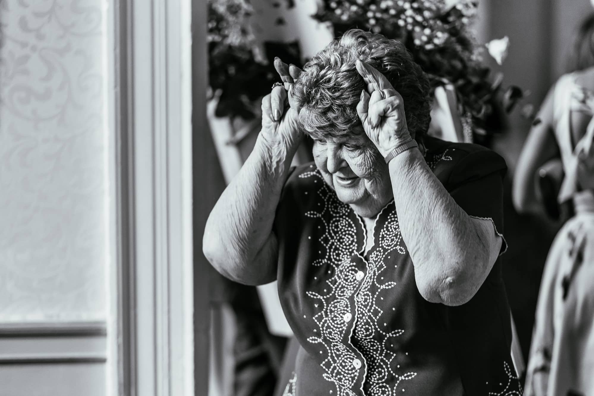 Brides nan messing around and laughing during the wedding reception at Mottram Hall.