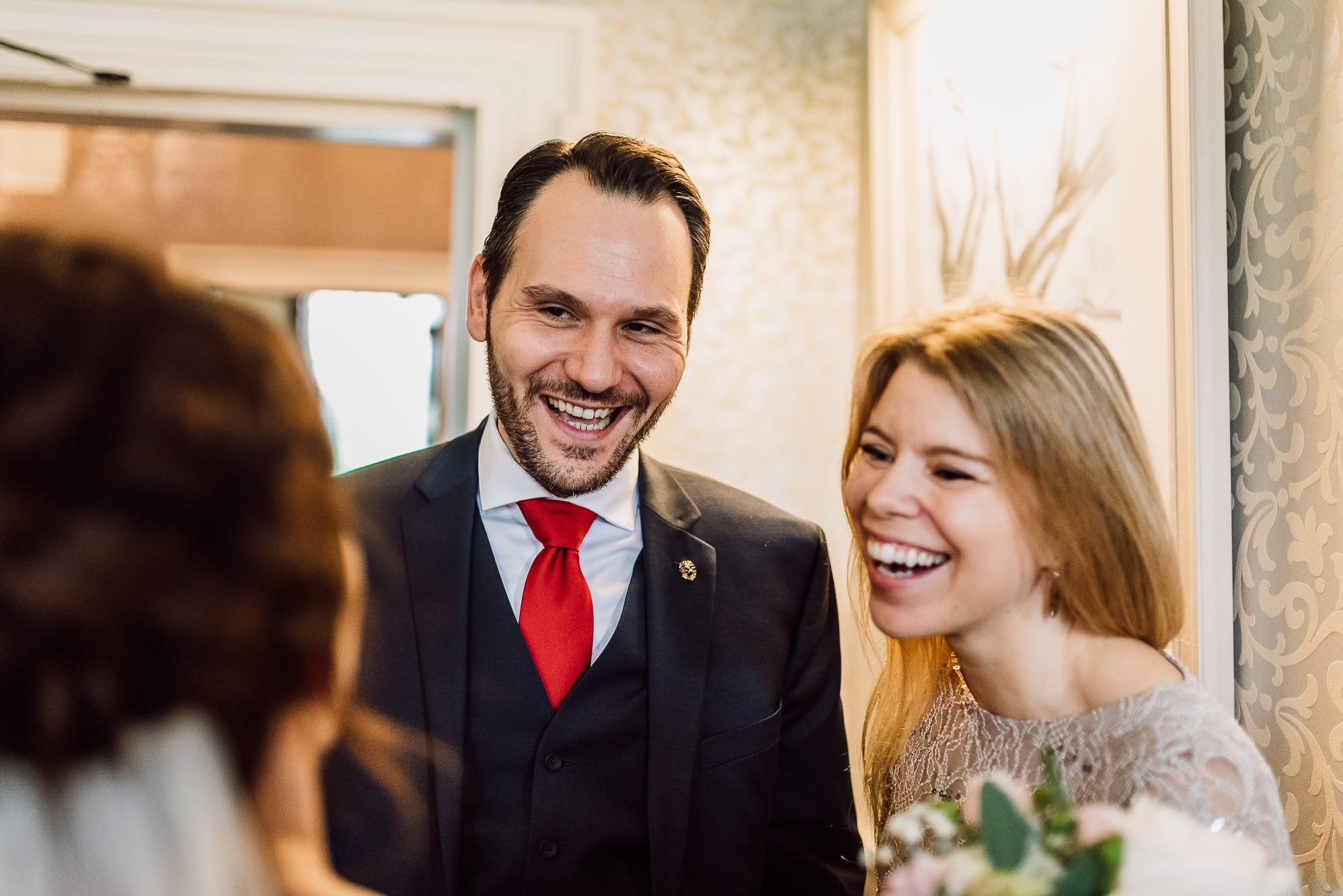 Guests laughing at Mottram Hall during the wedding reception