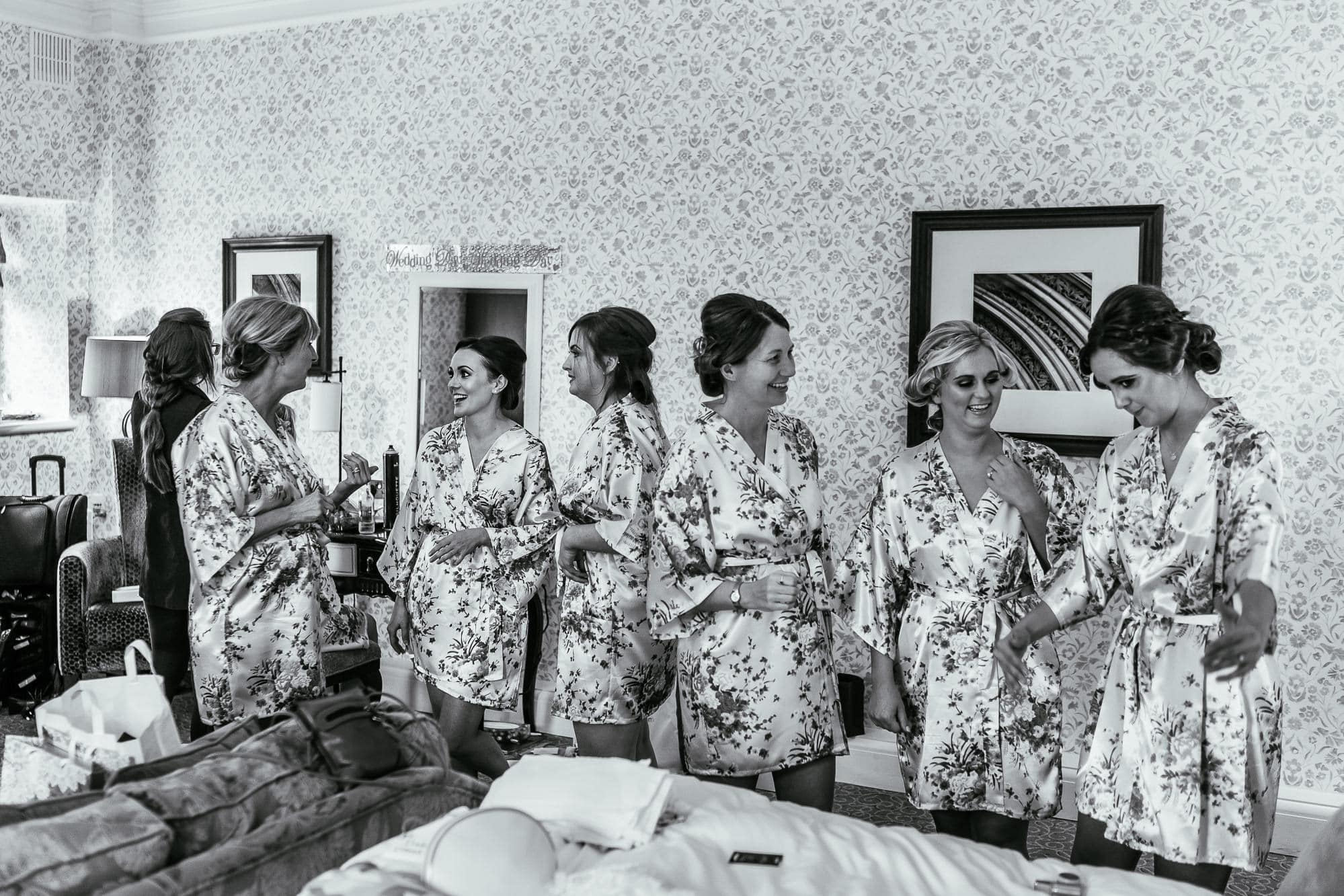 all the bridesmaids during bridal prep standing and chatting