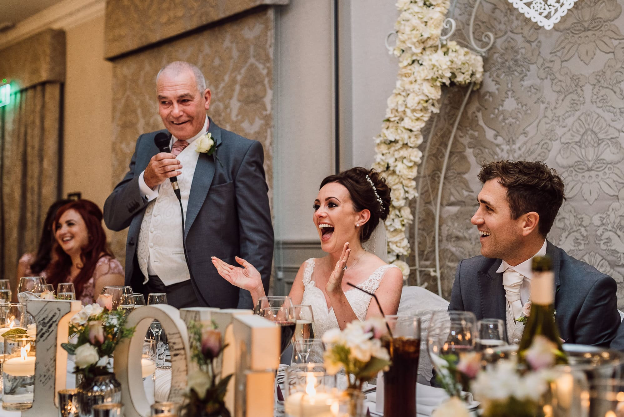 Bride laughing during her fathers speech at Mottram Hall