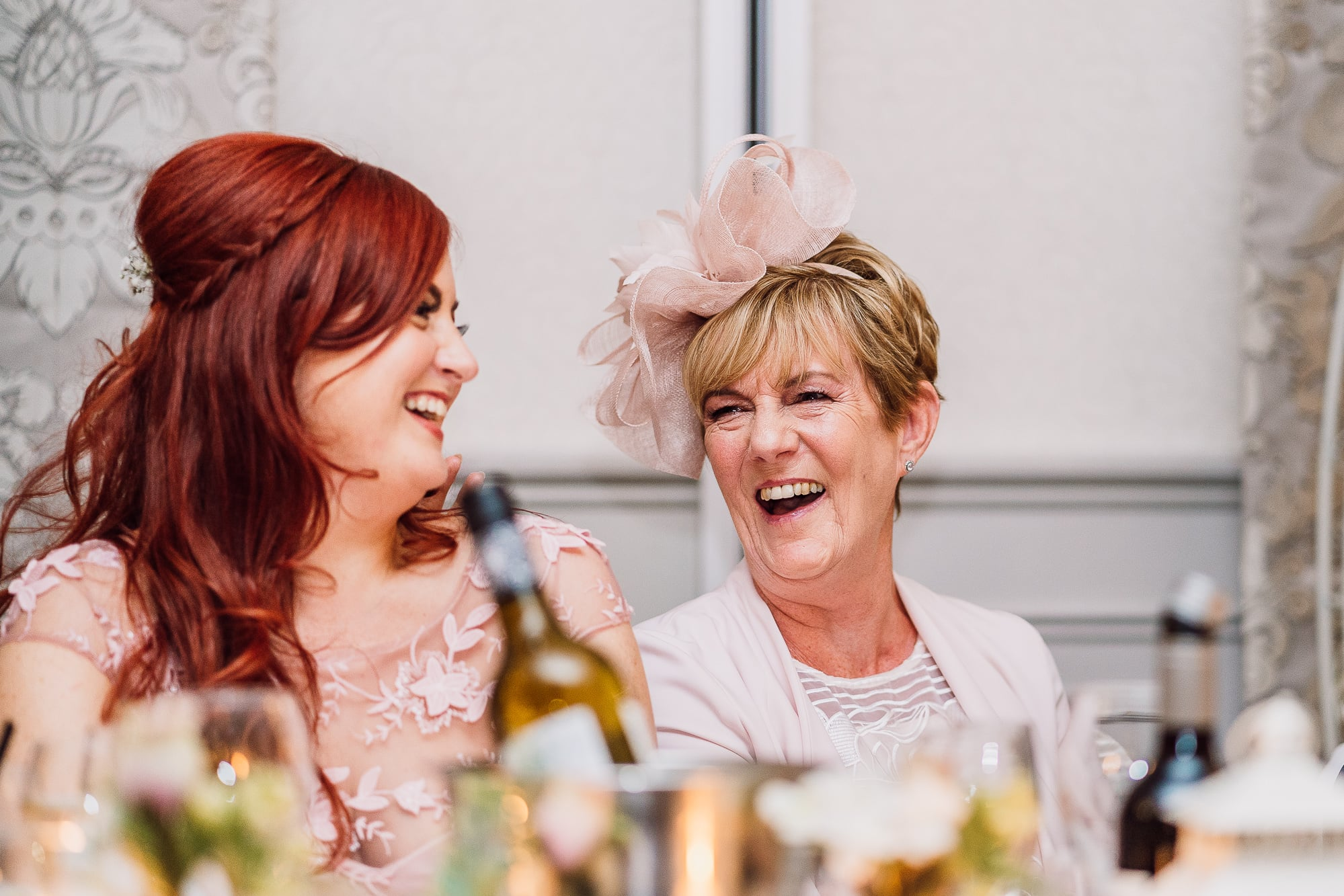 Mother of the bride laughing at Mottram Hall