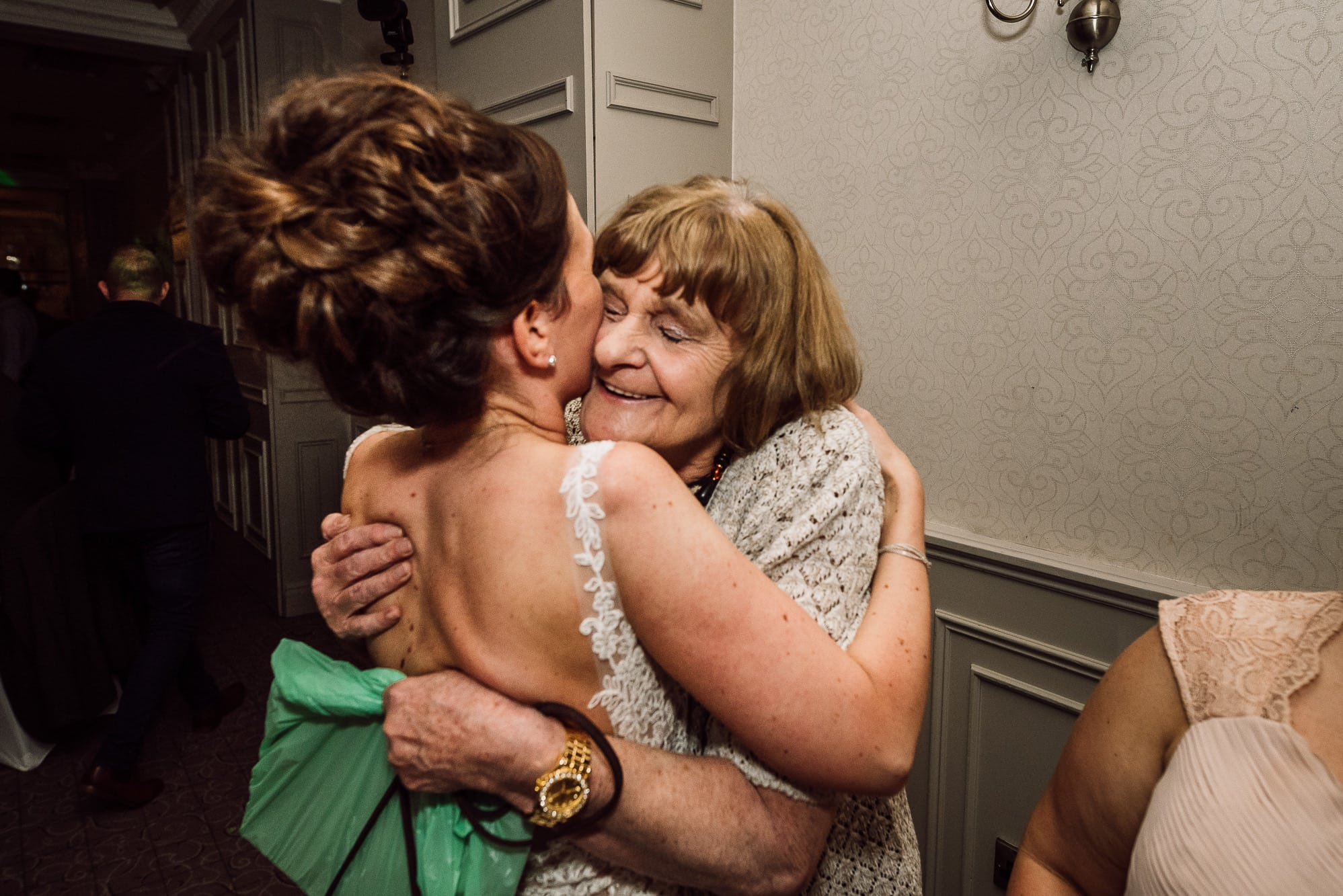 Bride hugging a relative at Mottram Hall