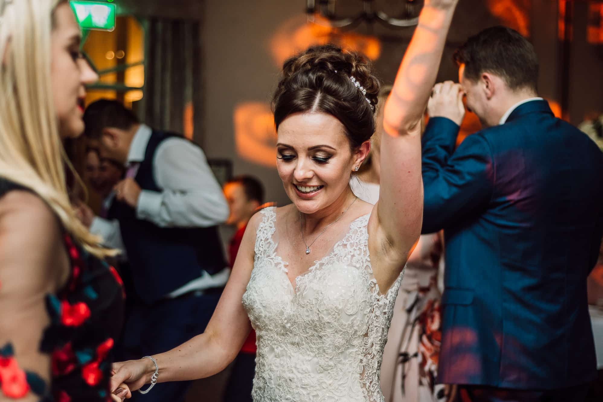 Beautiful bride dancing at Mottram Hall