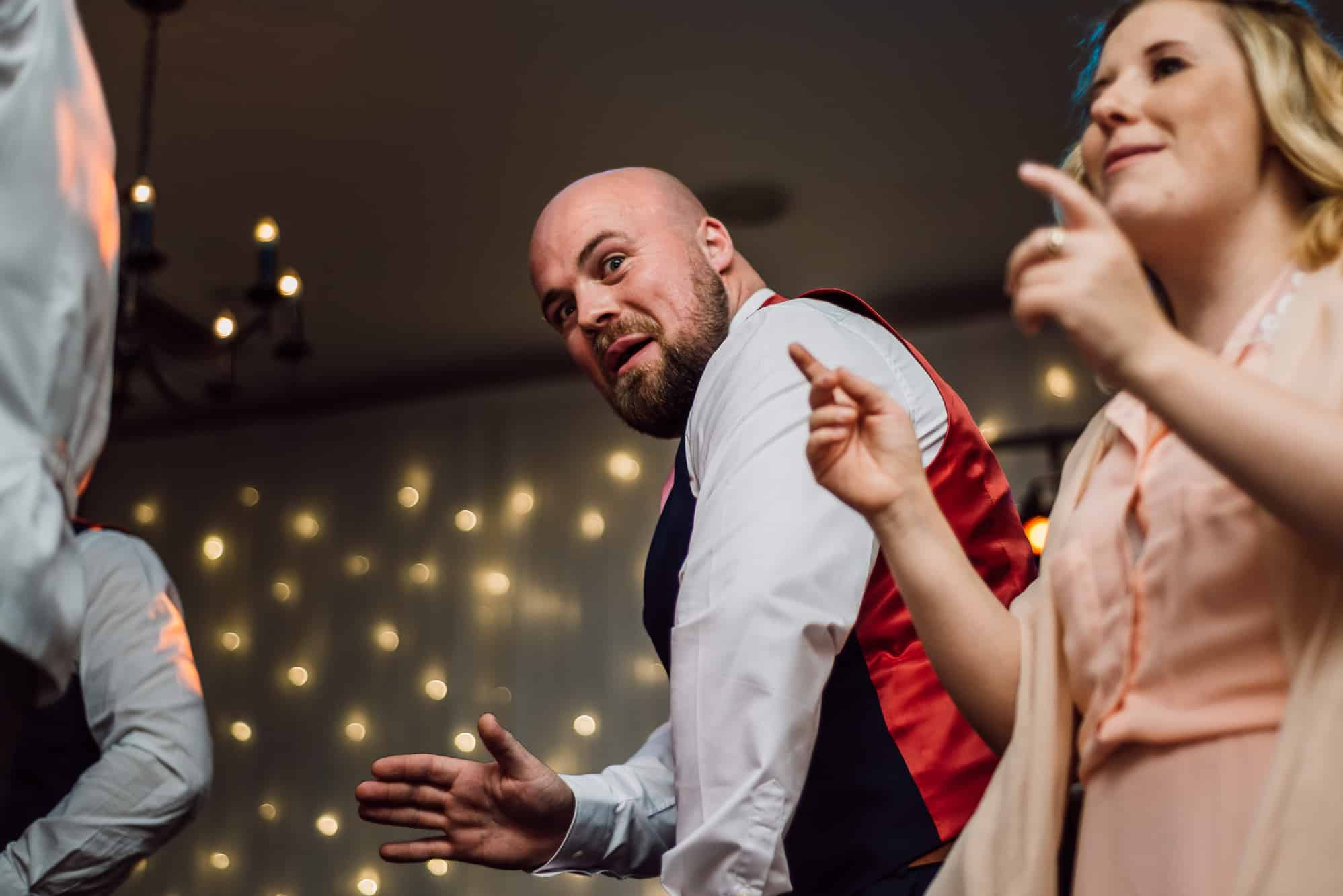 wedding guest dancing at Mottram Hall