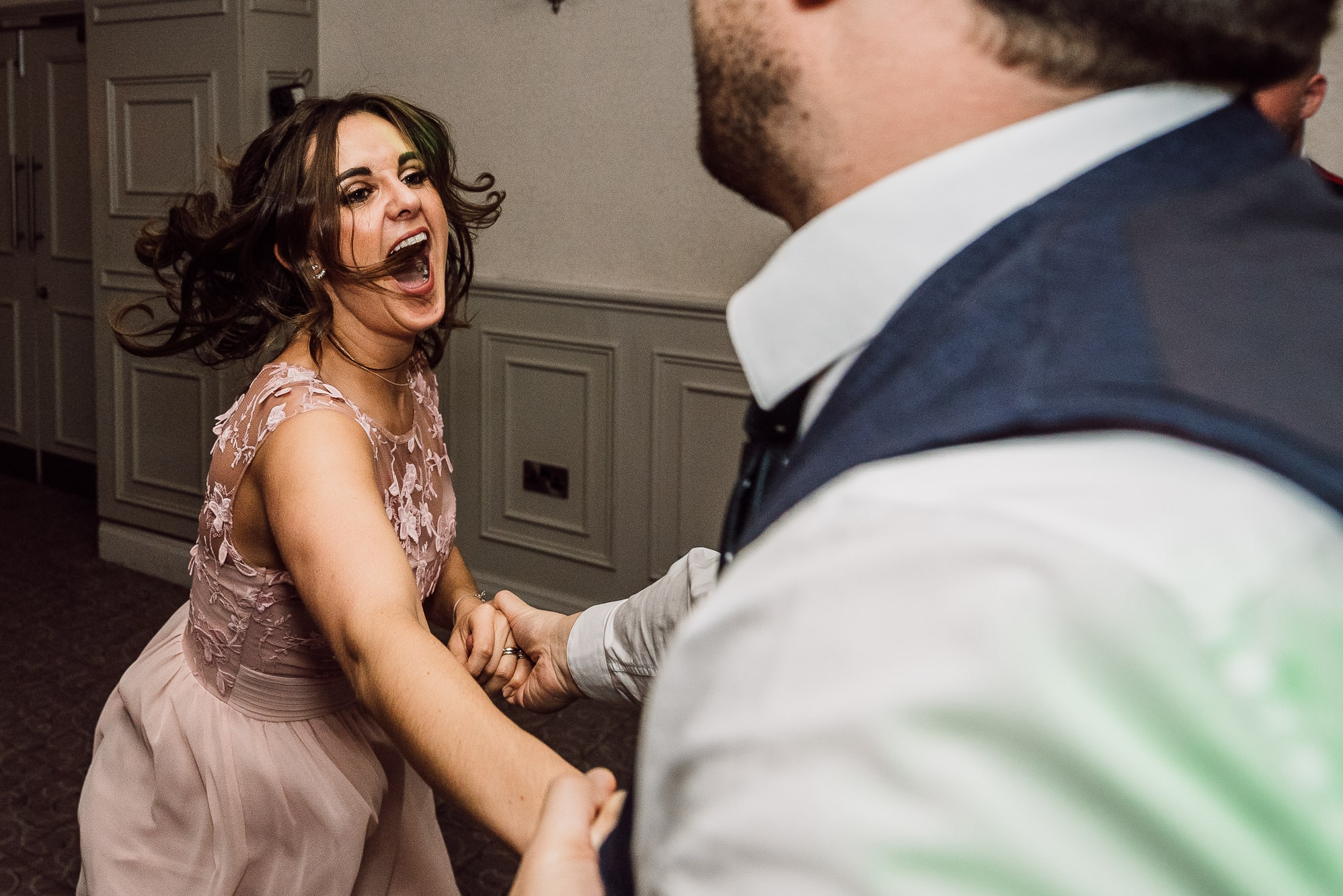 Bridesmaid dancing at Mottram hall