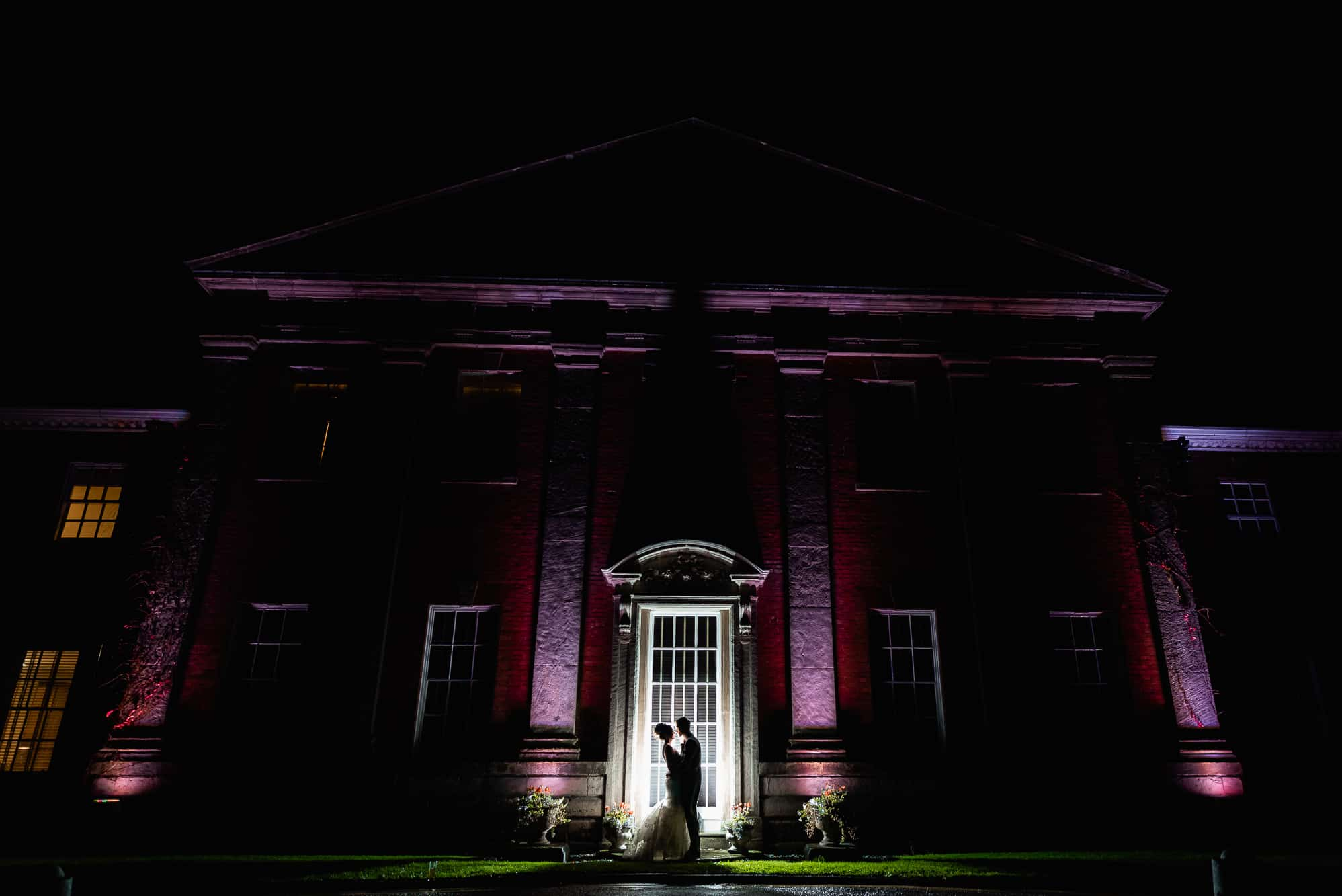 Mottram Hall wedding photography - a photo of the couple outside at night