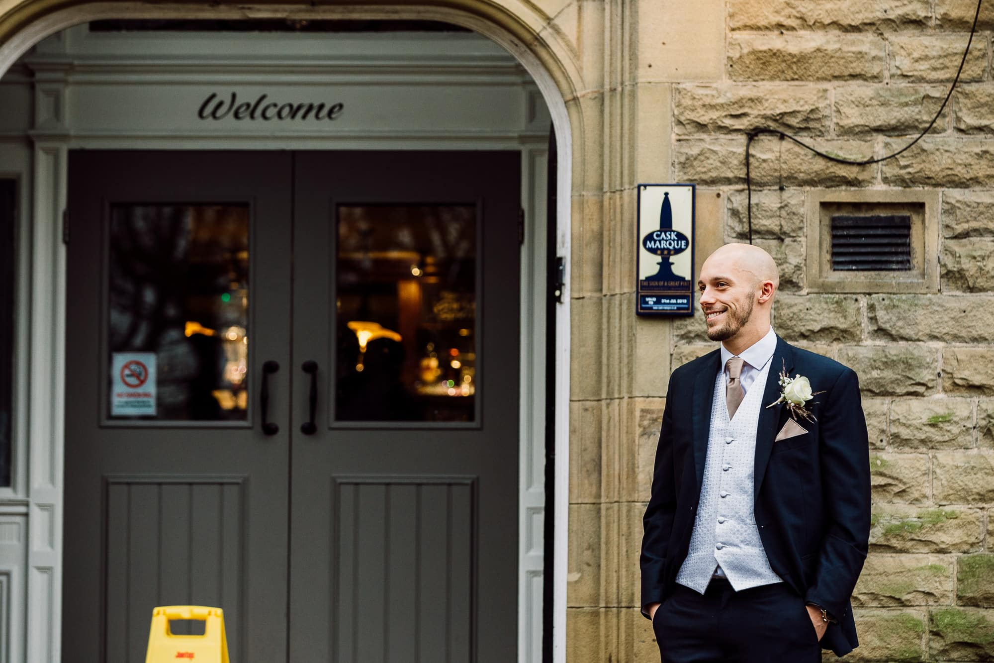 Groom outside the pub before the service