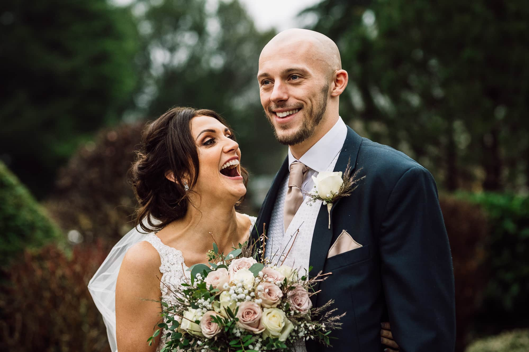 Bride and groom laughing at Mitton hall