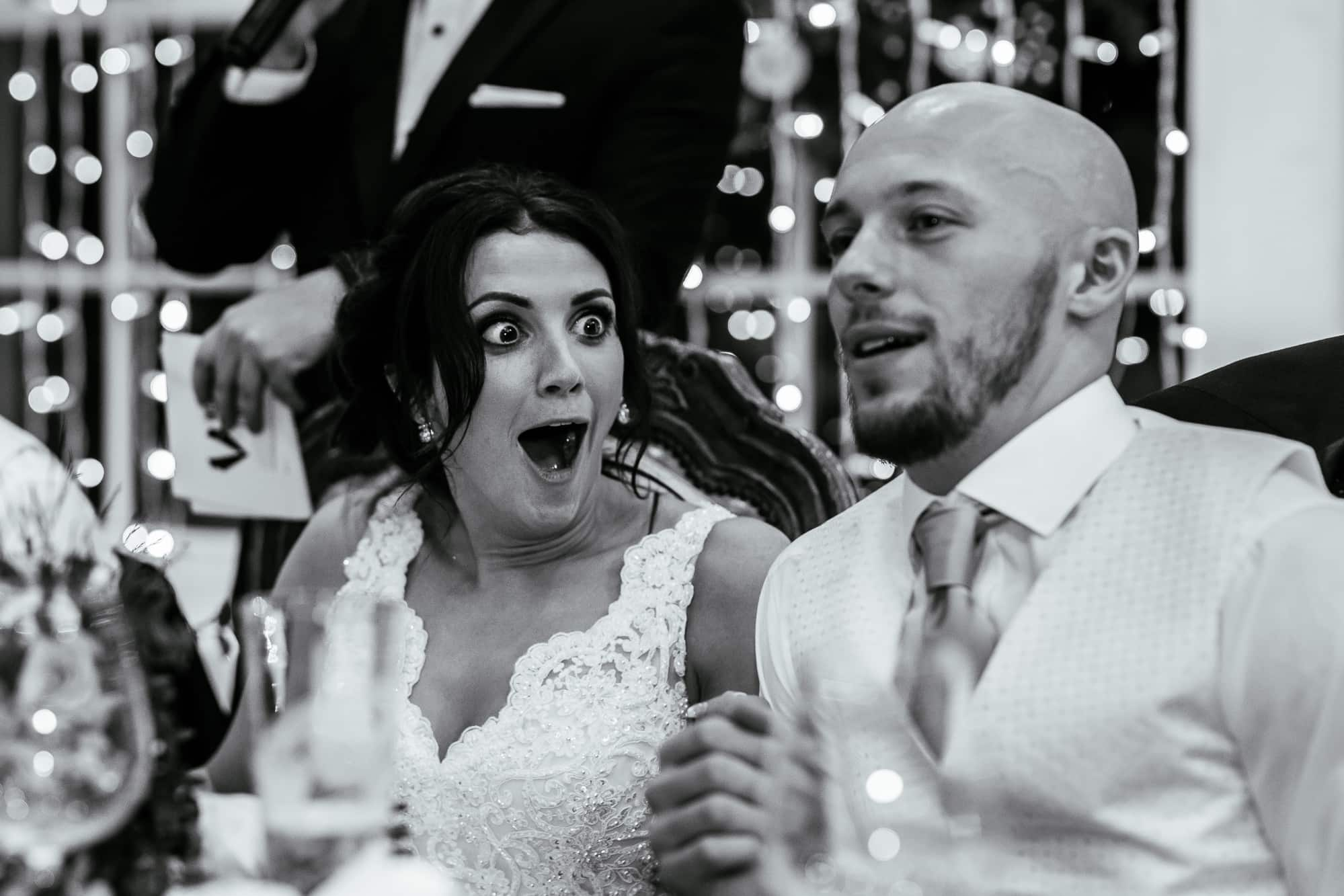 Bride reacting to a story during the reception