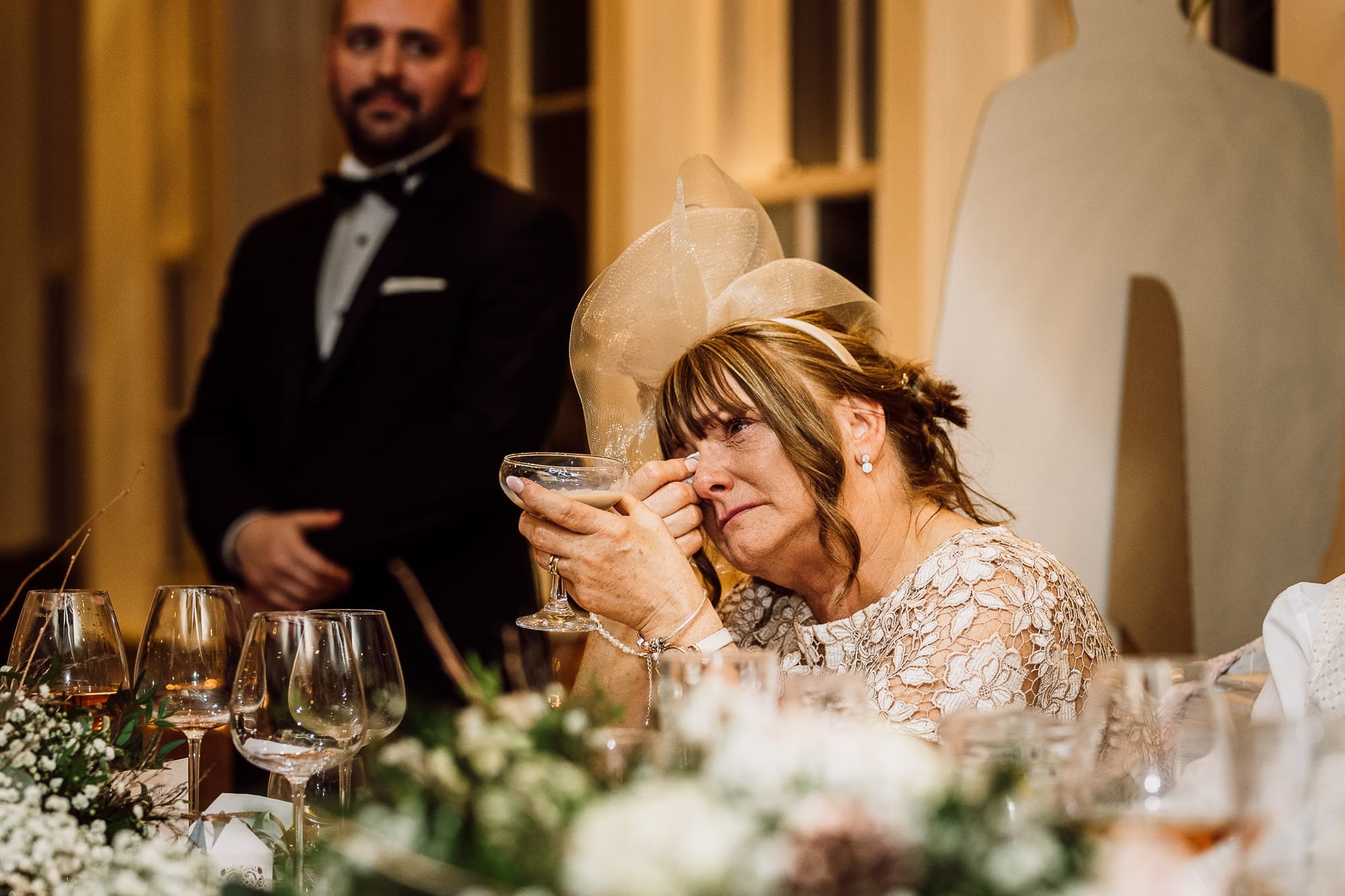 Mother of the bride crying during speeches at Mitton Hall