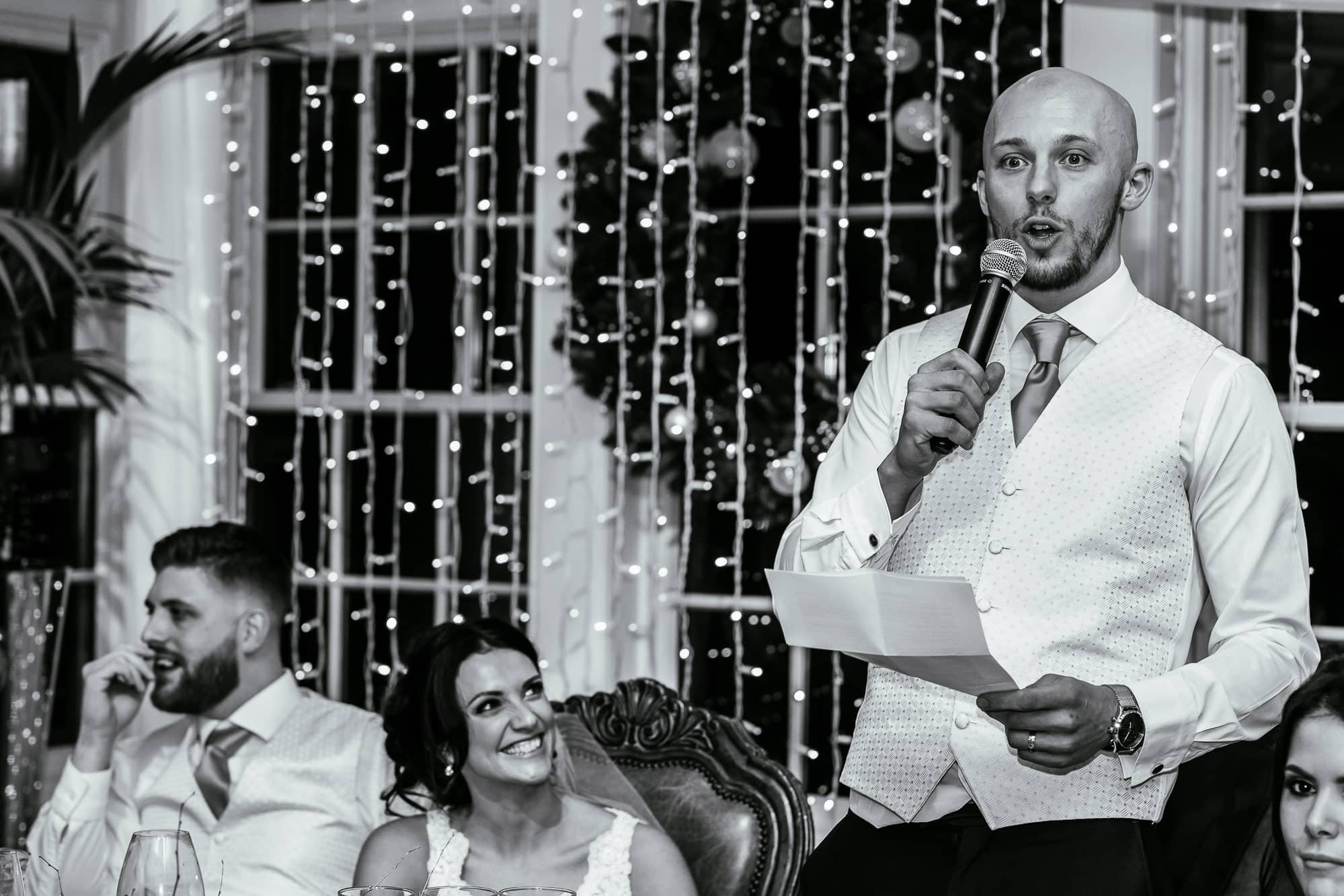 Groom speech and bride laughing