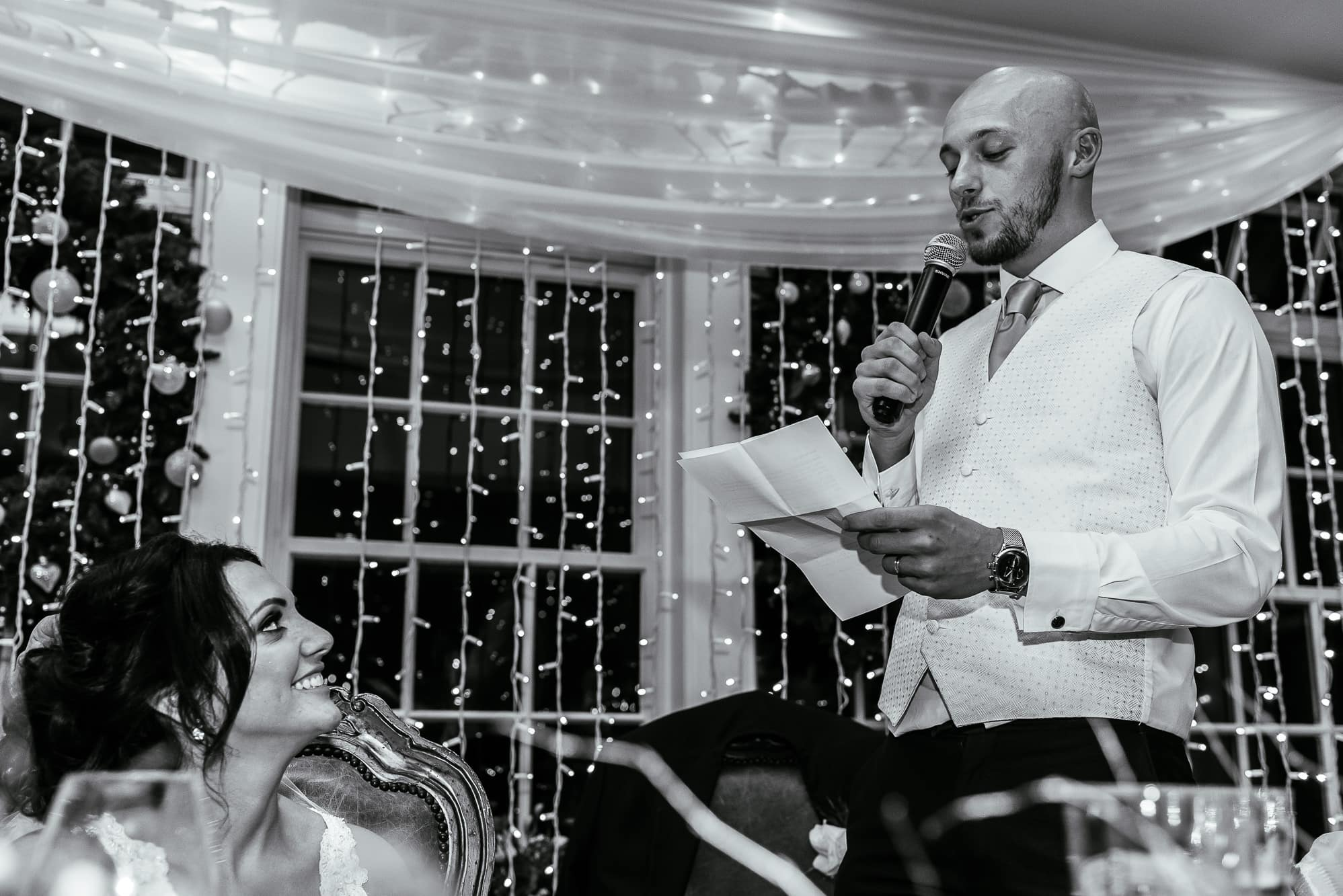 Groom speech with bride looking on at Mitton Hall