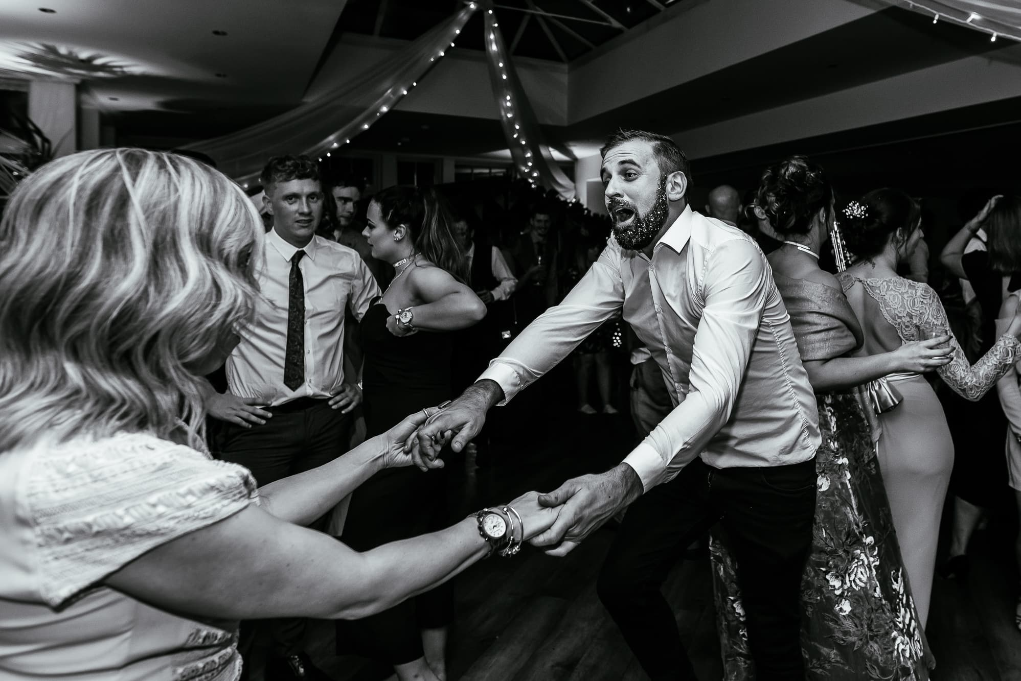 Guests dancing at Mitton hall at a winter wedding