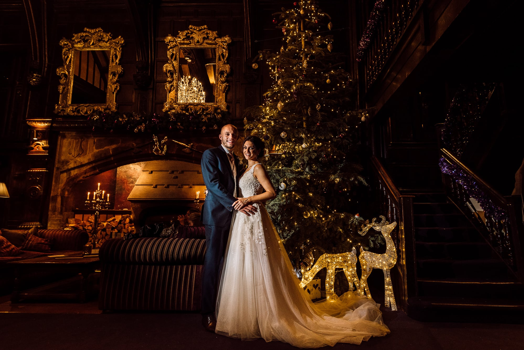 Bride and groom at Mitton Hall in front of the Christmas tree
