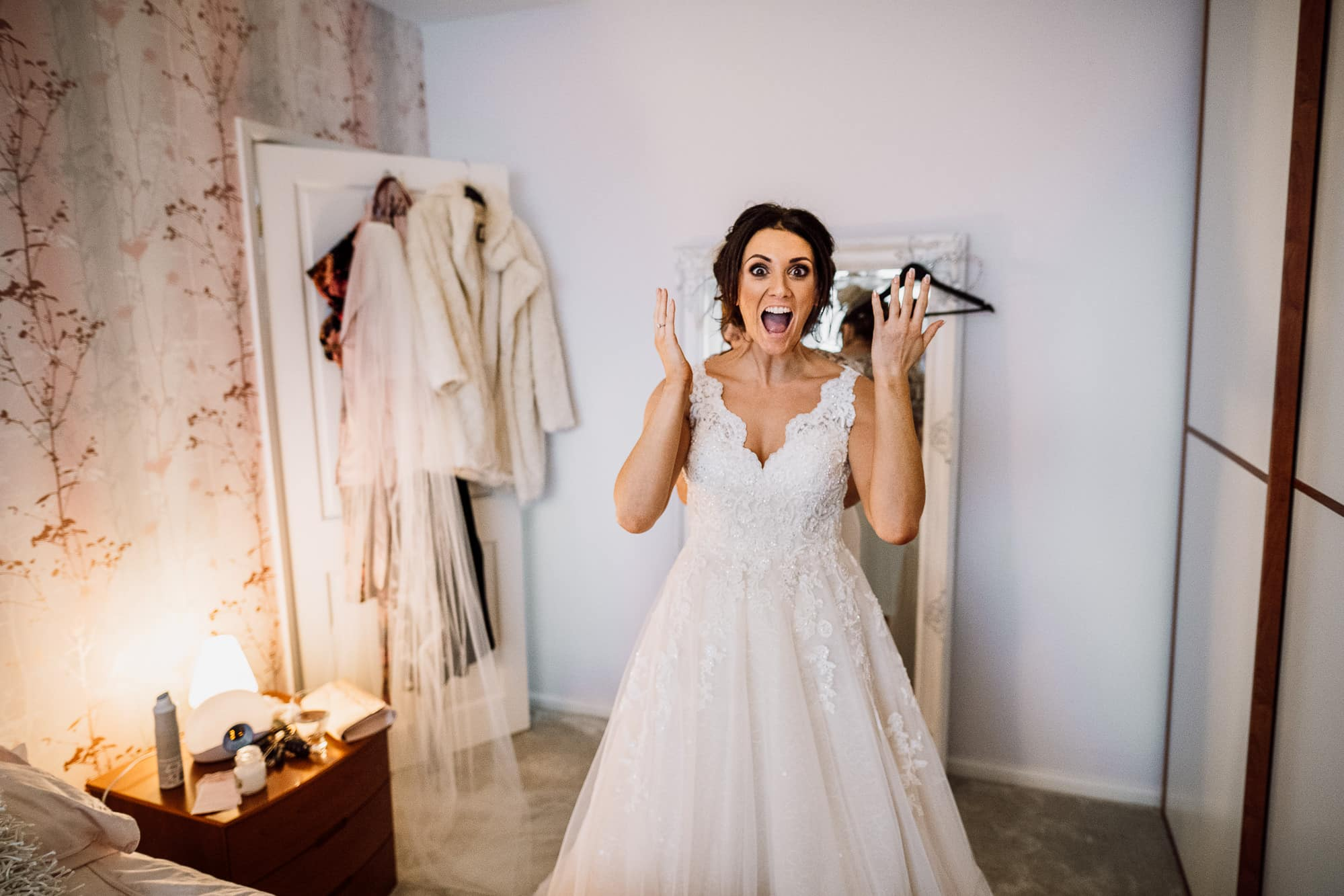 Bride reacting to getting dressed