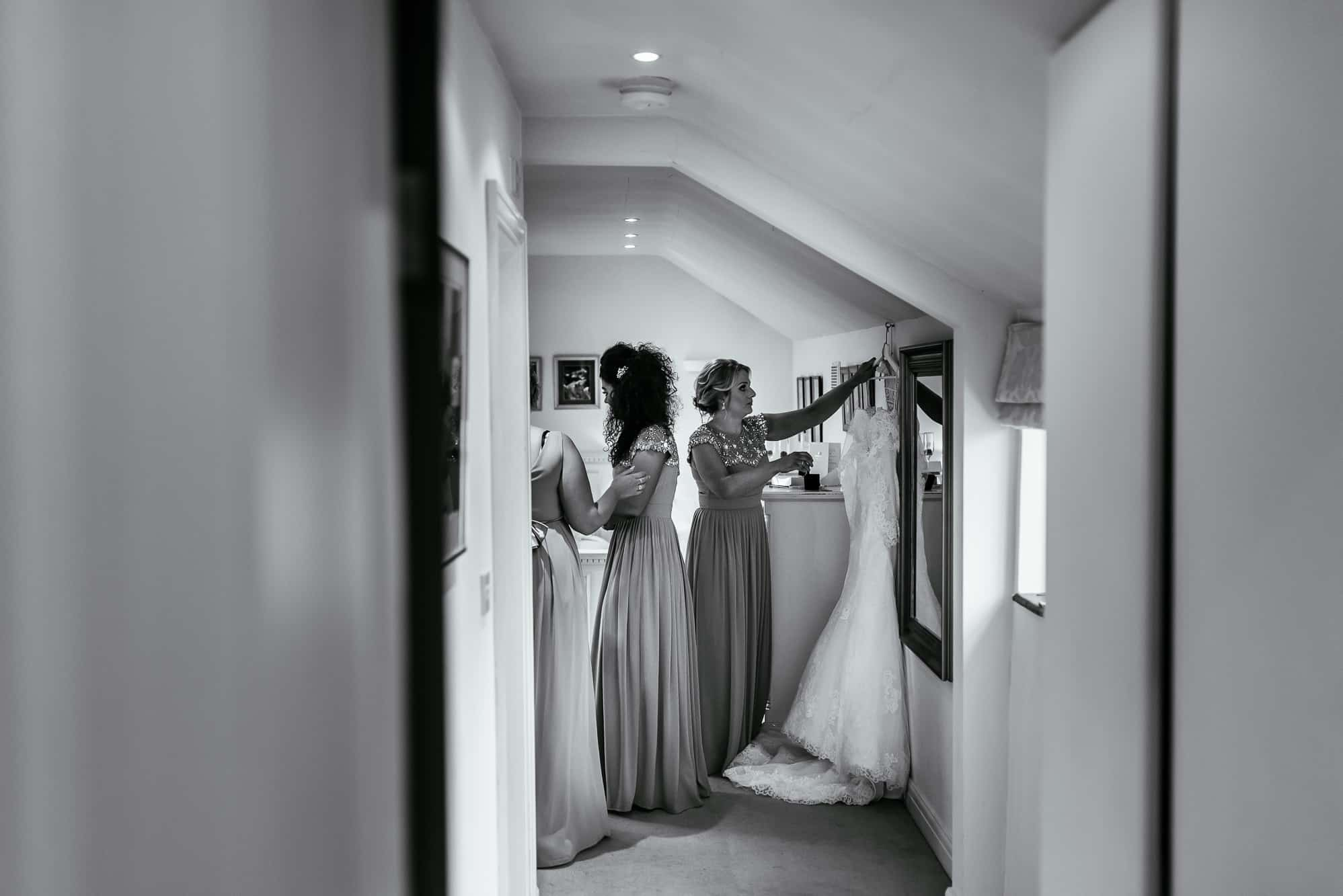 Bridesmaid getting the dress down
