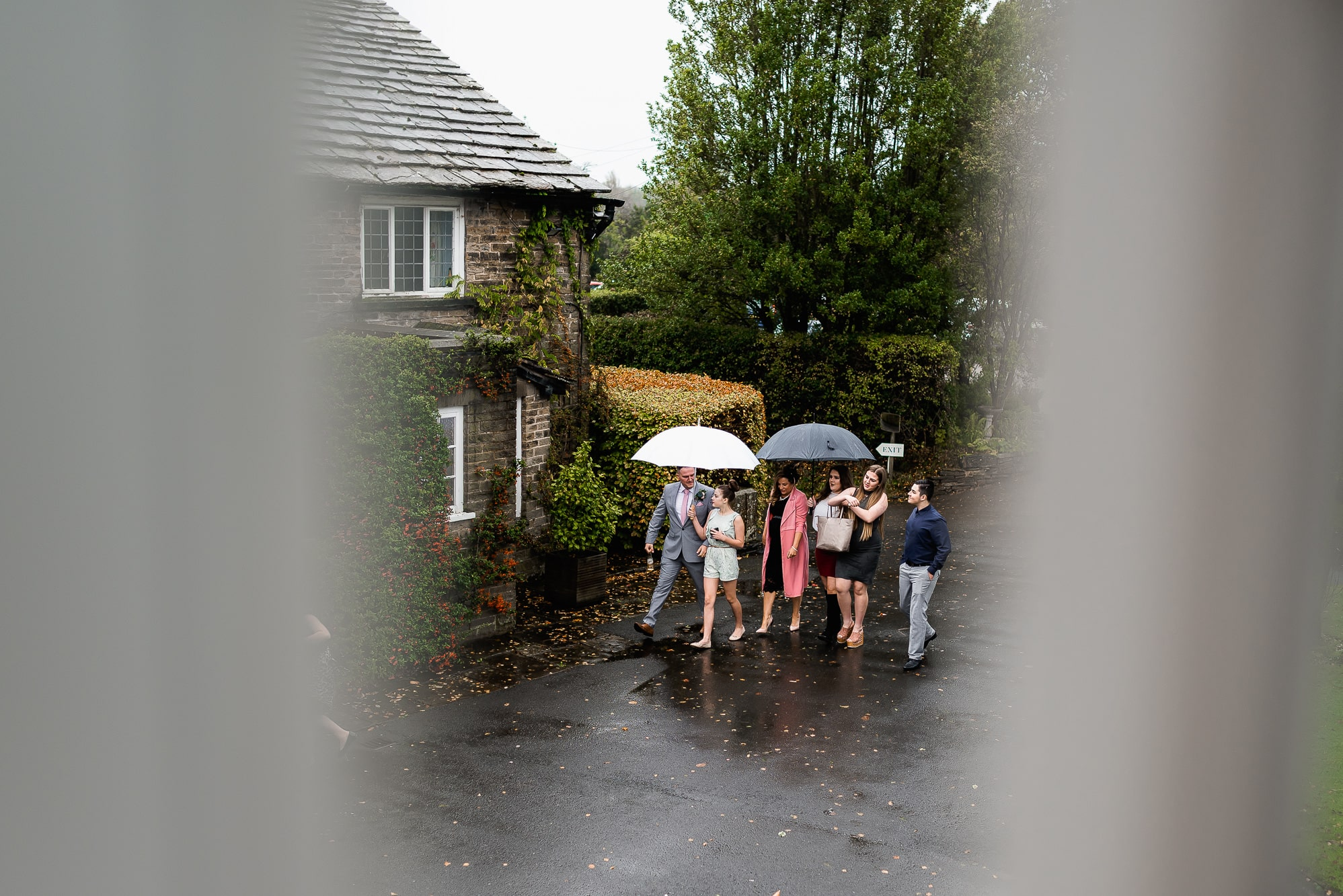 Guests arriving in the rain at Hilltop Country House