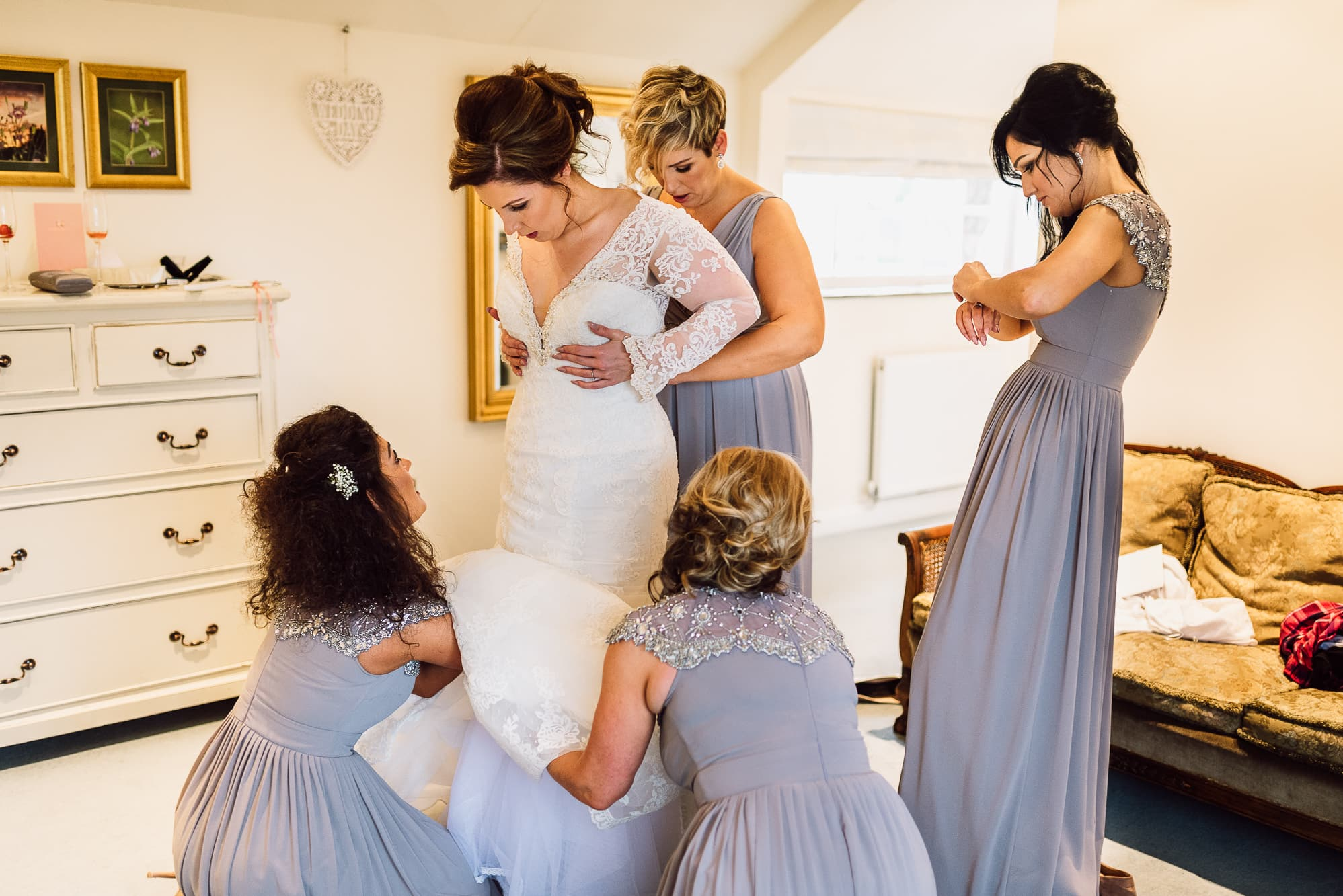Bride getting into her dress at Hilltop Country House