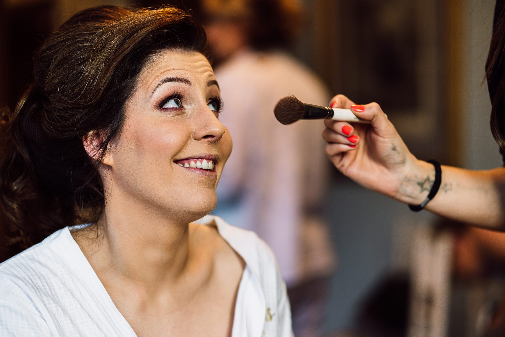 Bride having her make up put on