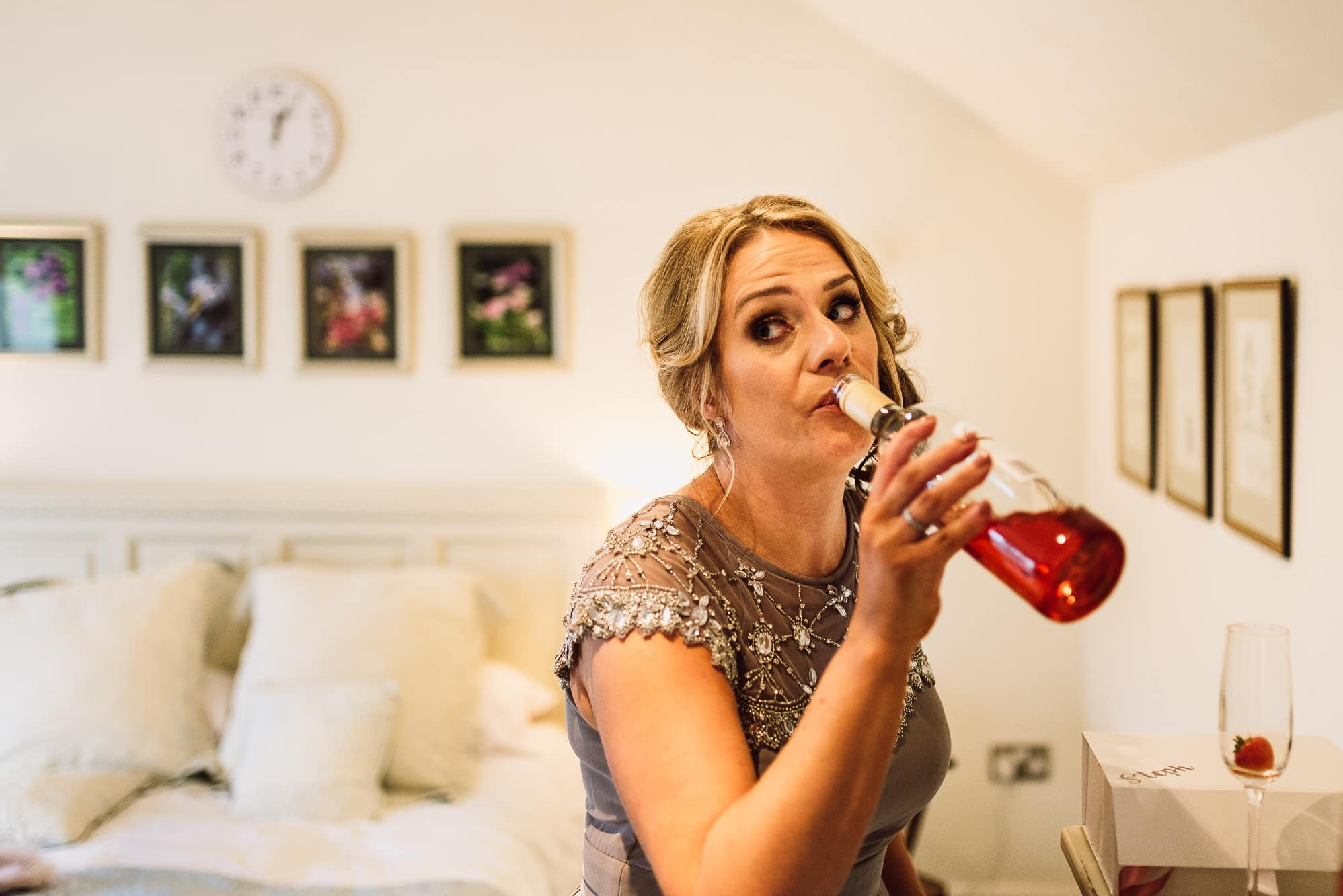 Bridesmaid drinking a bottle of wine