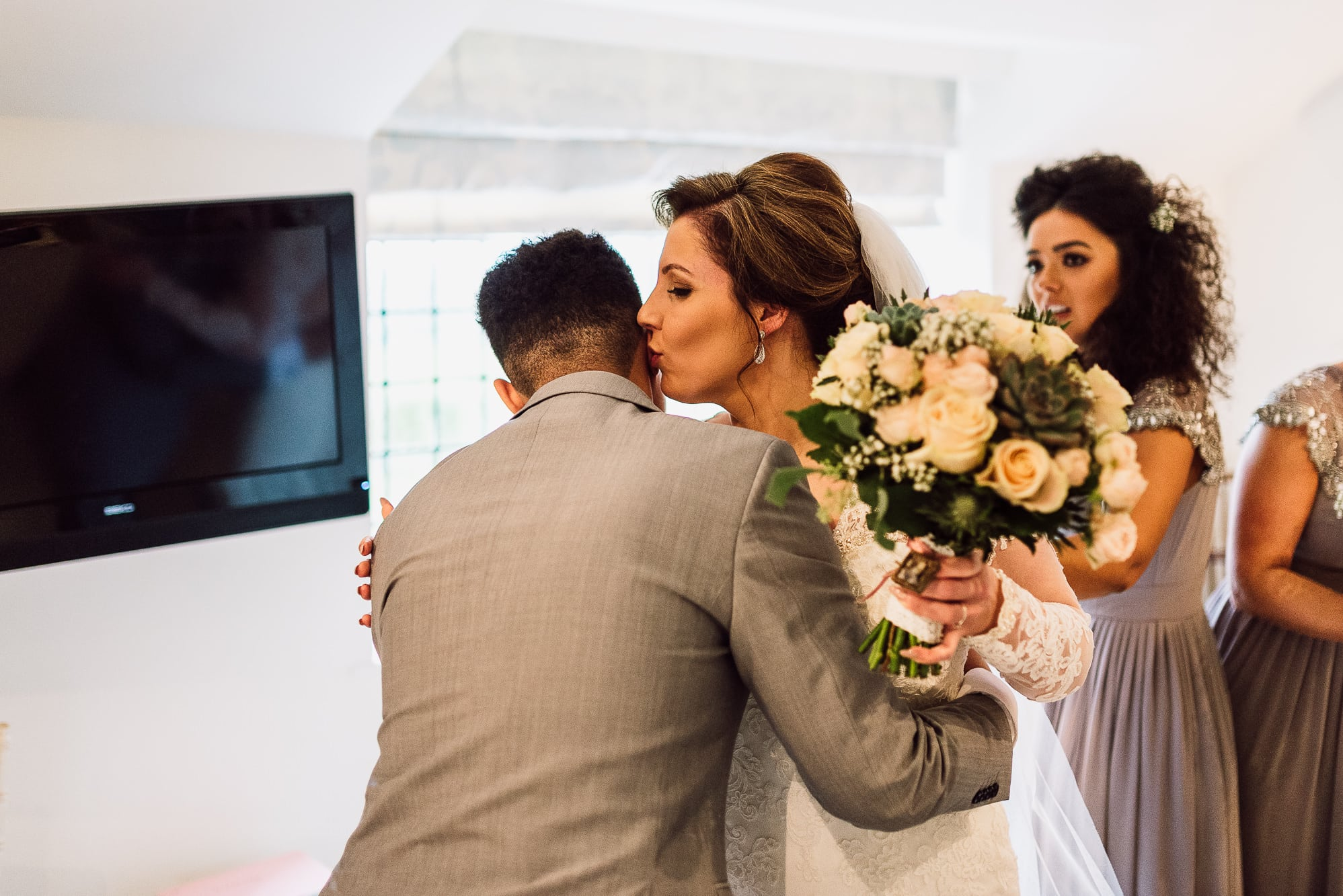 Bride seeing her son who was giving her away for the first time at Hilltop Country House