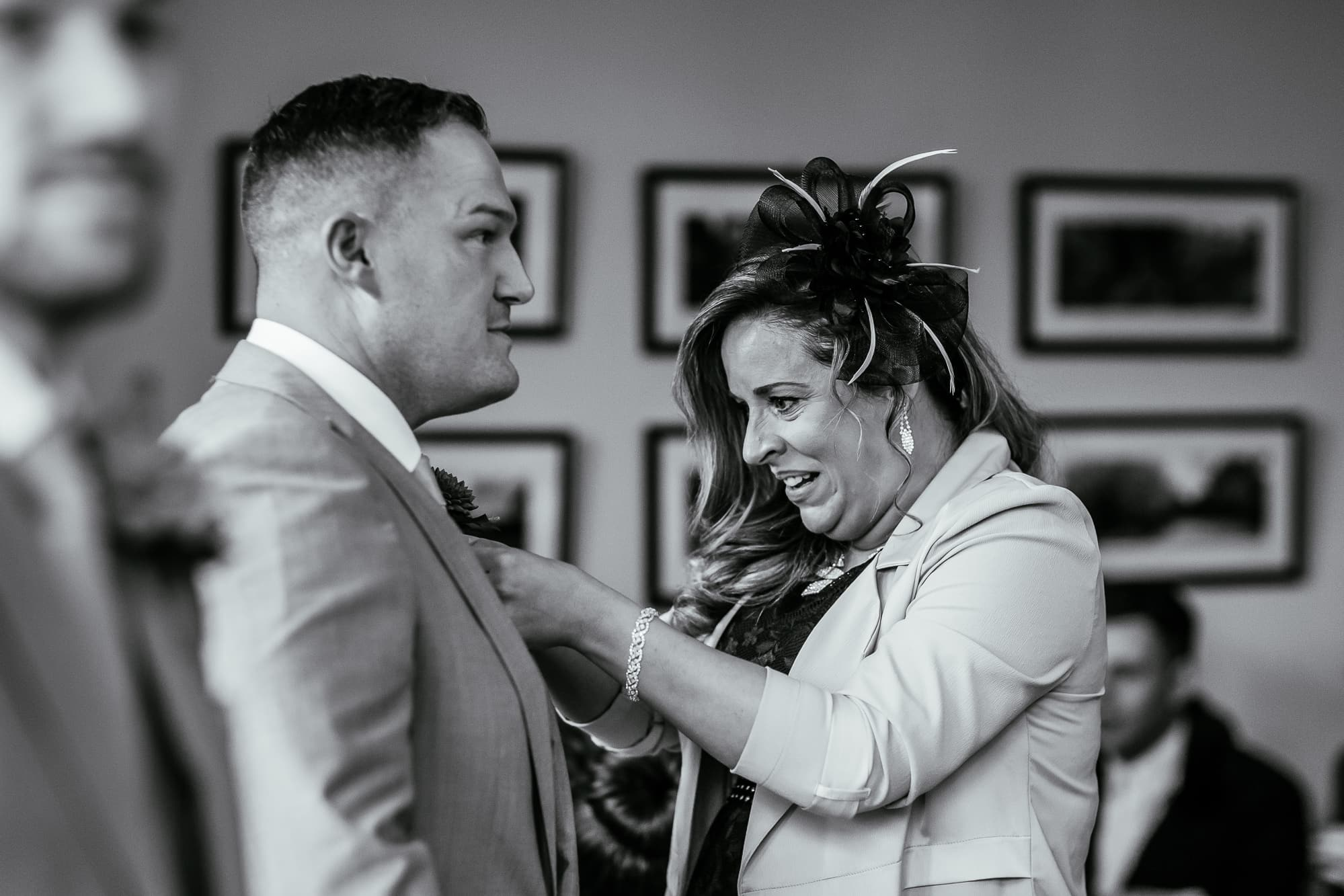Best man having his flower attached