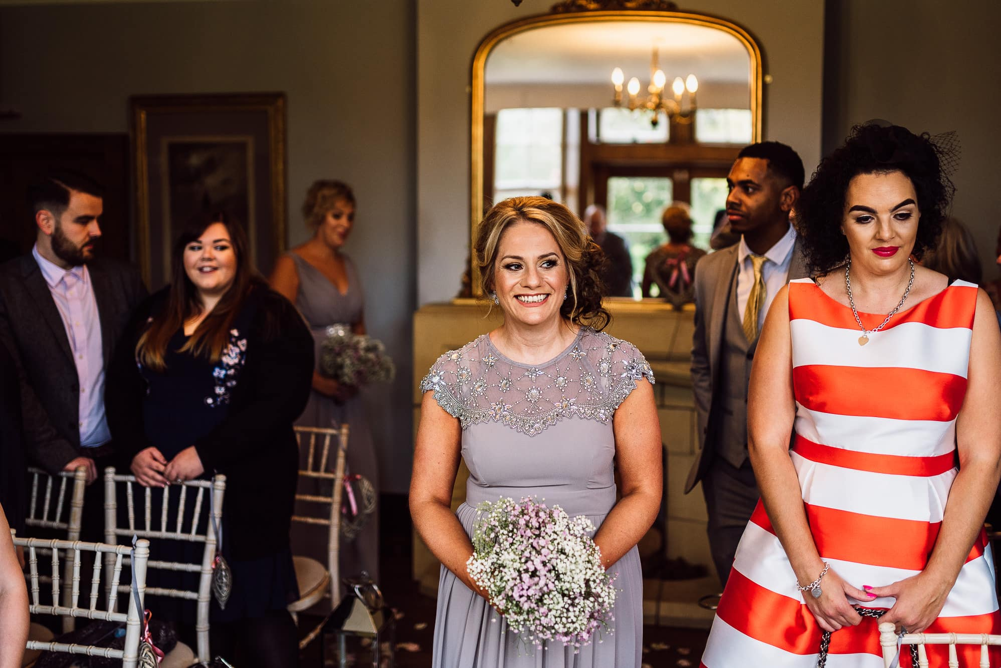Bridesmaid walking into the service at Hilltop Country House
