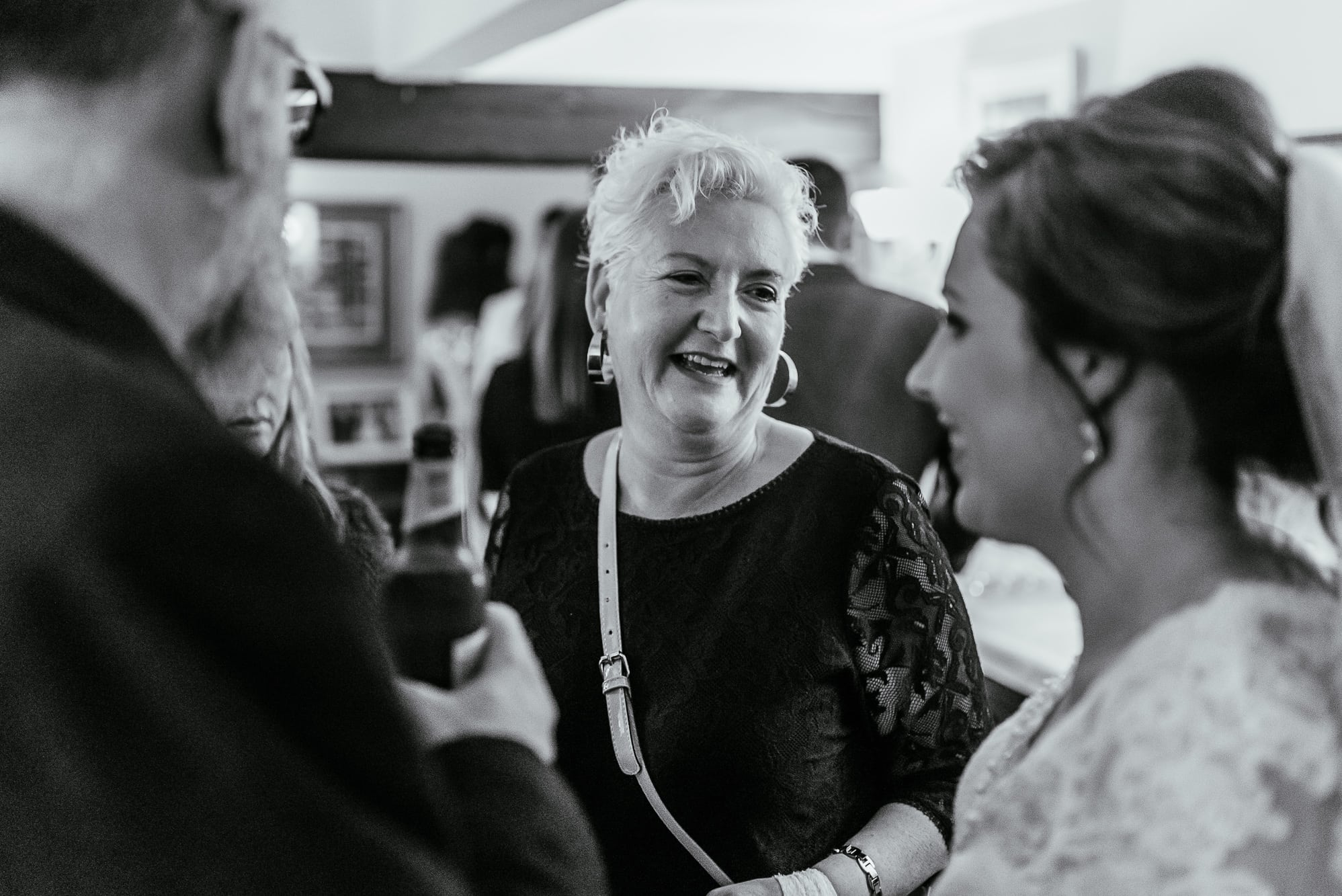 A guest laughing with the bride