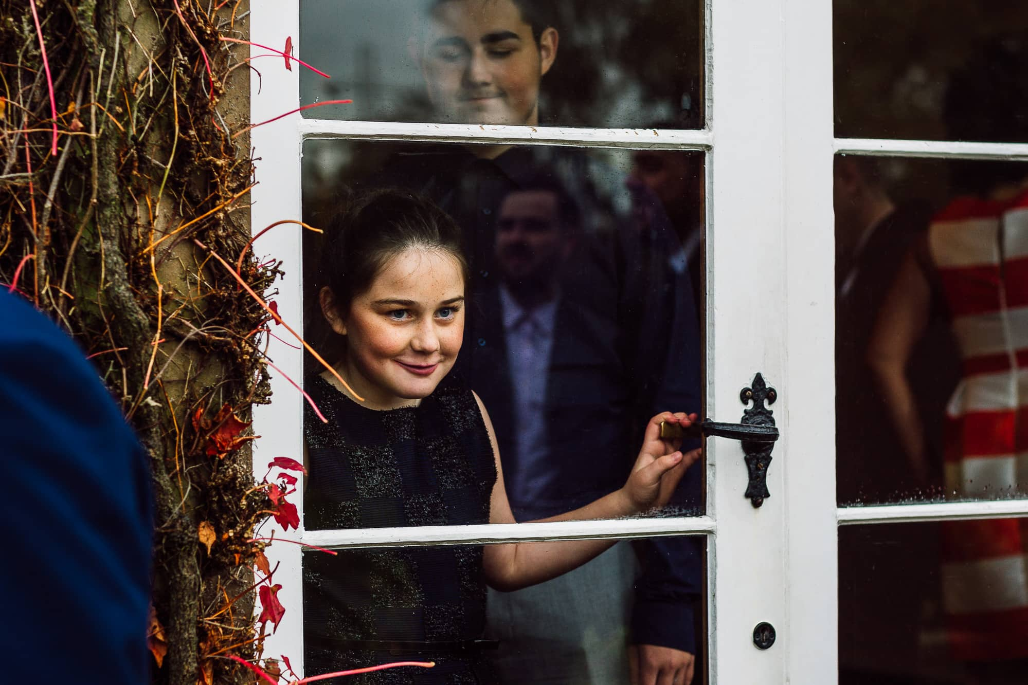 girl looking through the window at Hilltop Country House