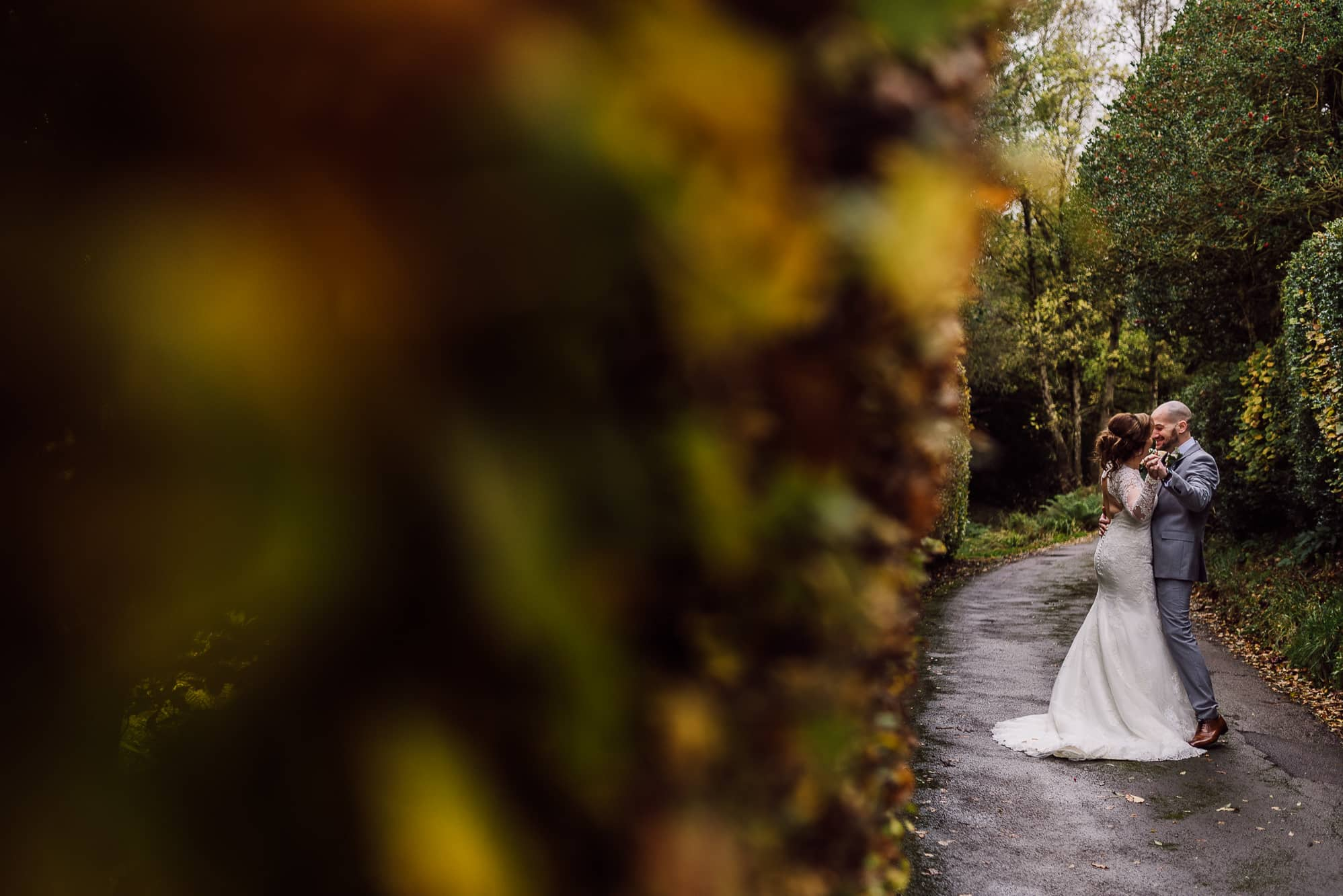 Bride and groom walking down the road at Hilltop Country House