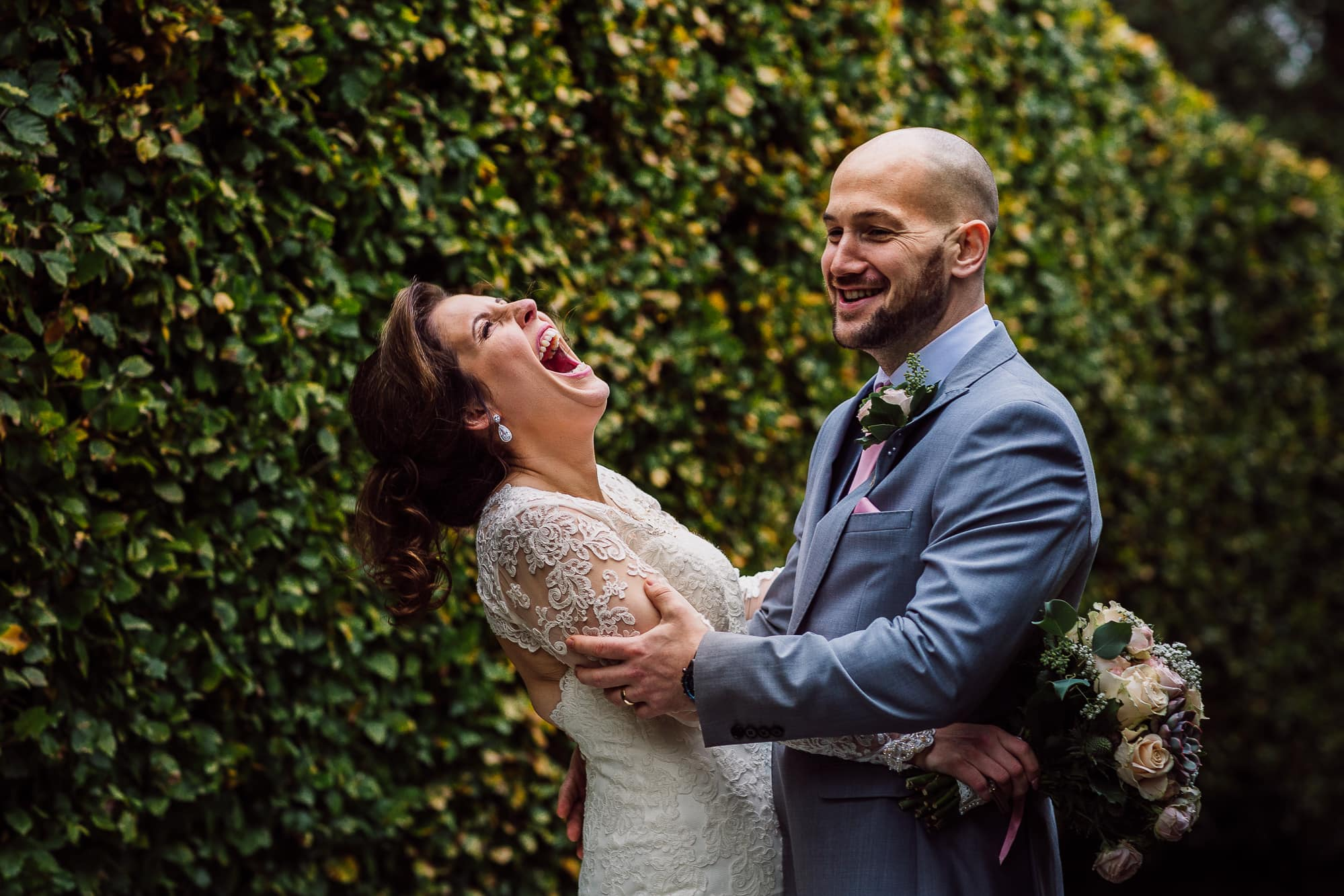 Bride laughing at Hilltop County house