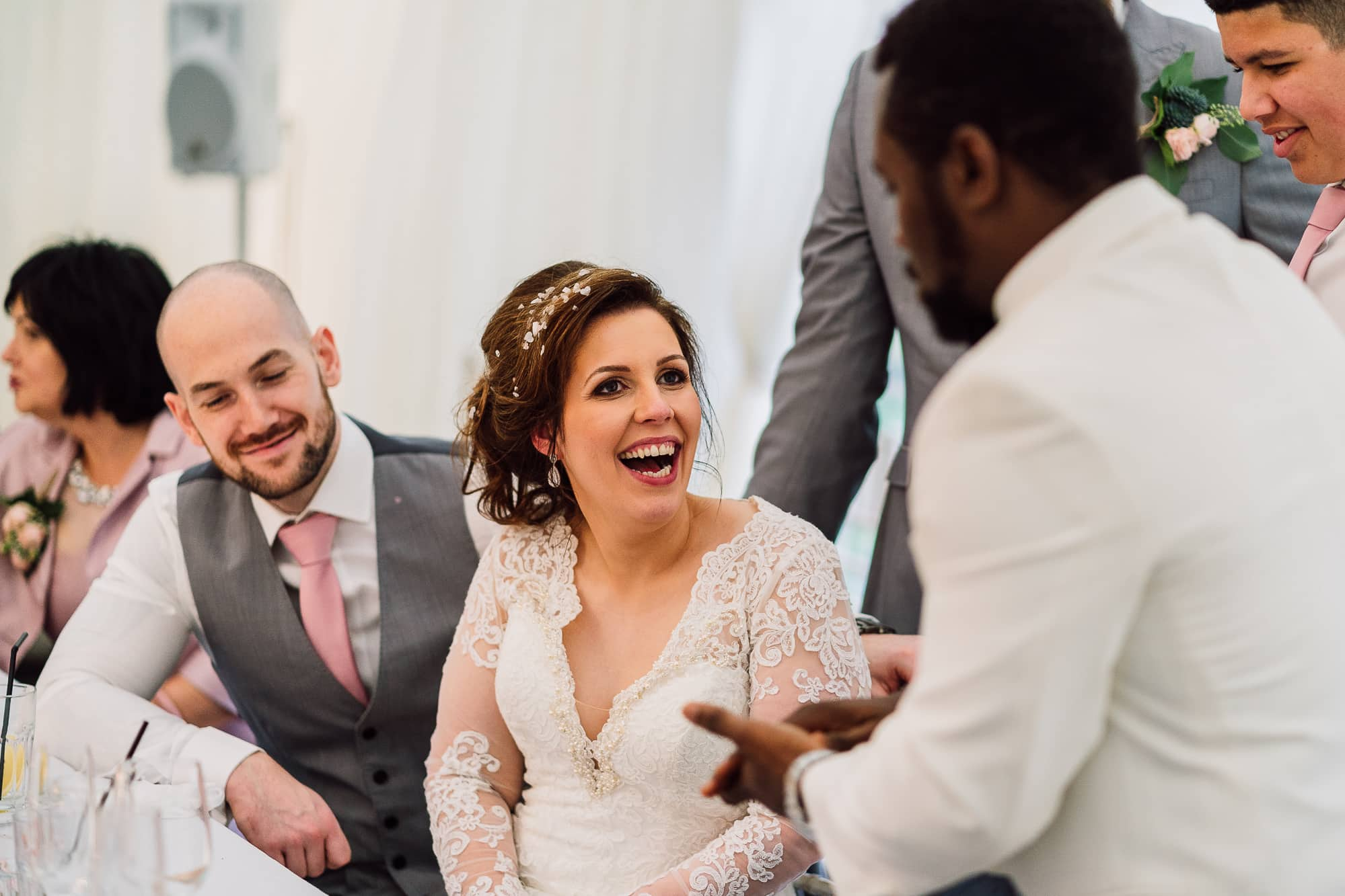 Bride laughing as a result of magic from The King of Aces
