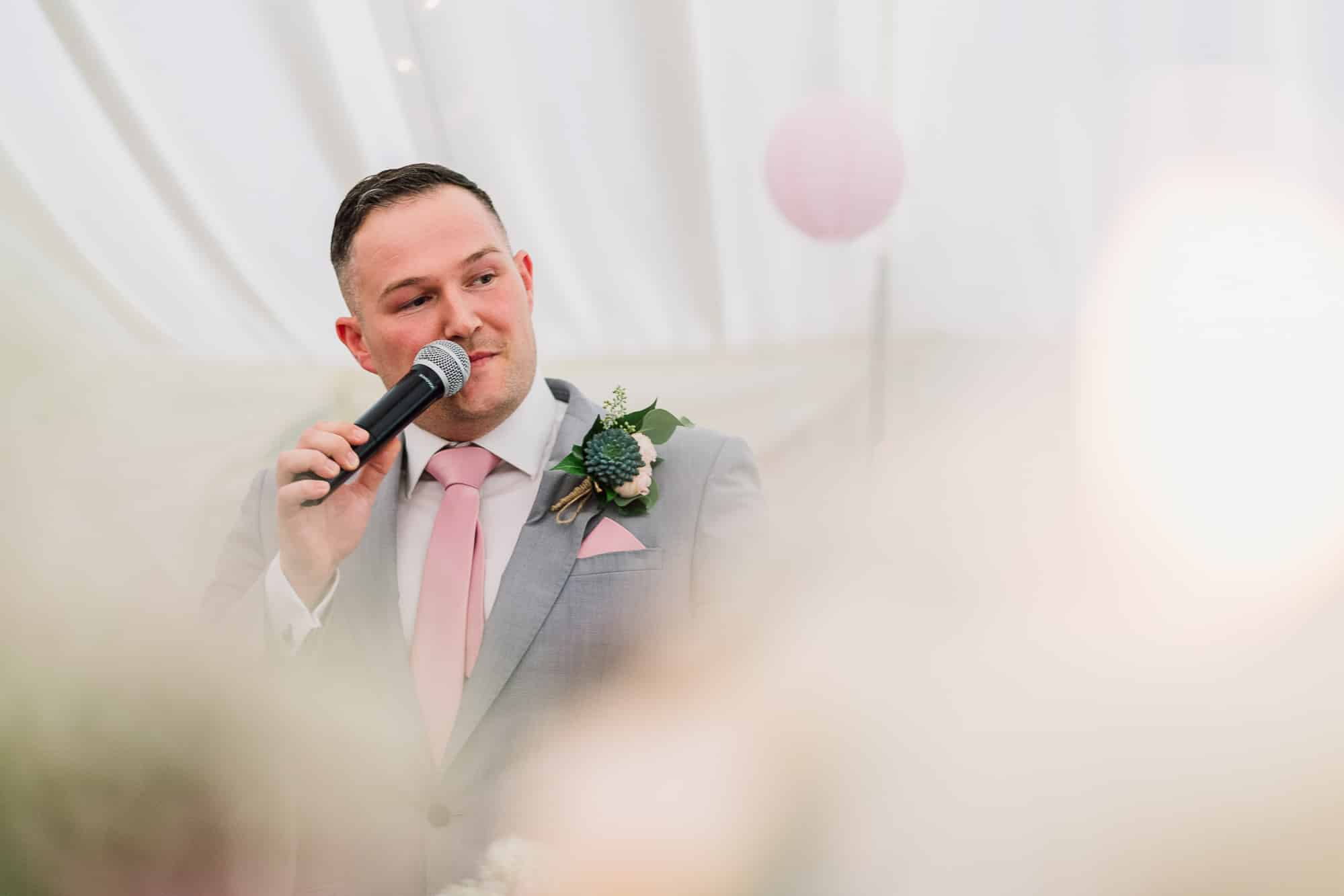 Best man speech shot through flowers