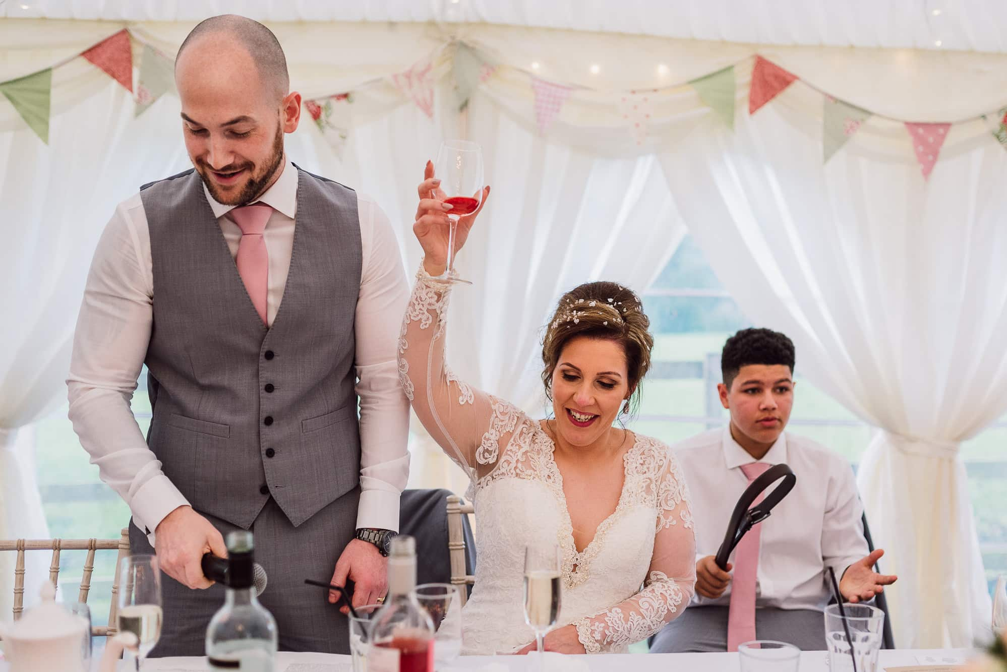 Bride raising her glass at Hilltop Country House