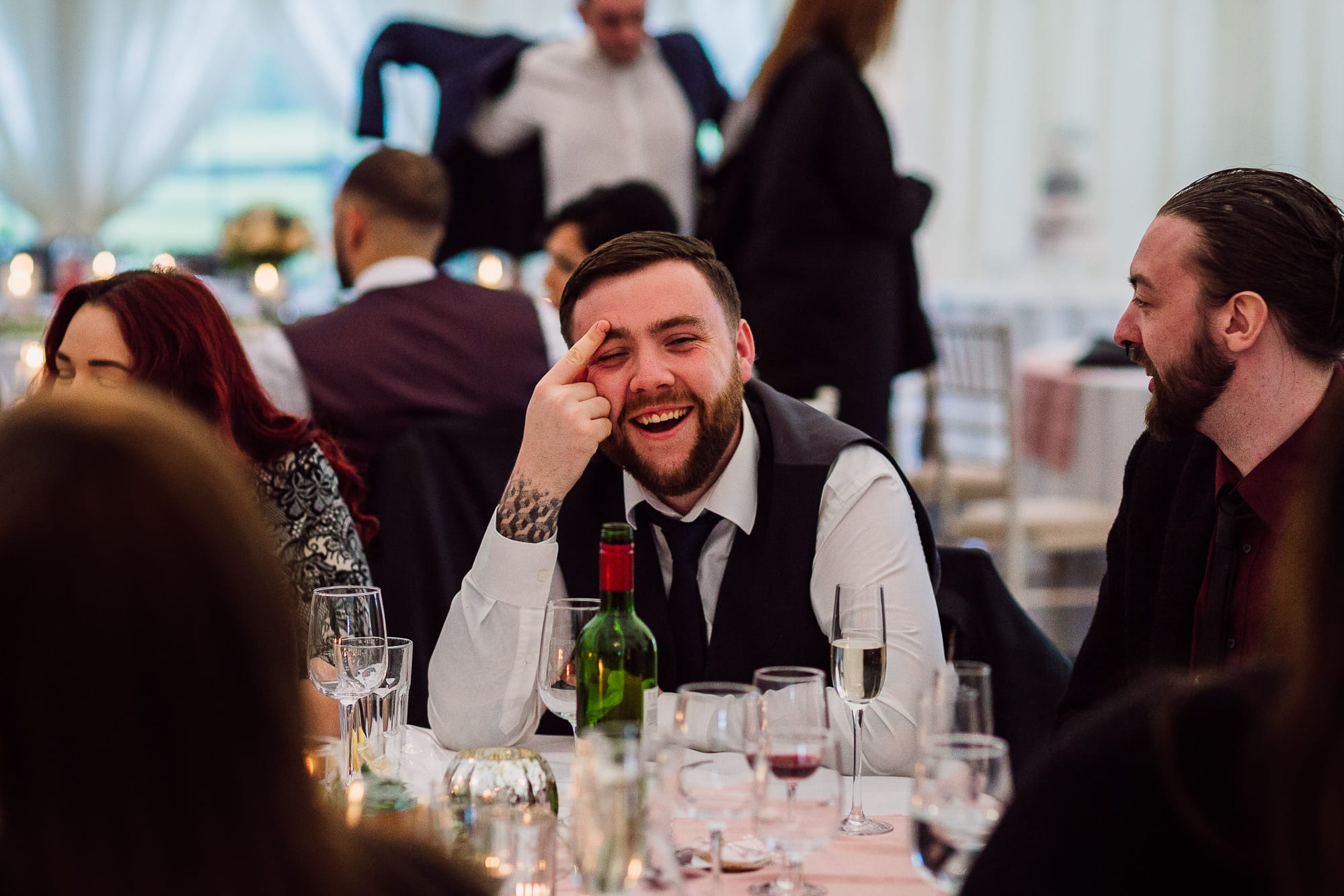 Guest laughing at the dinner table
