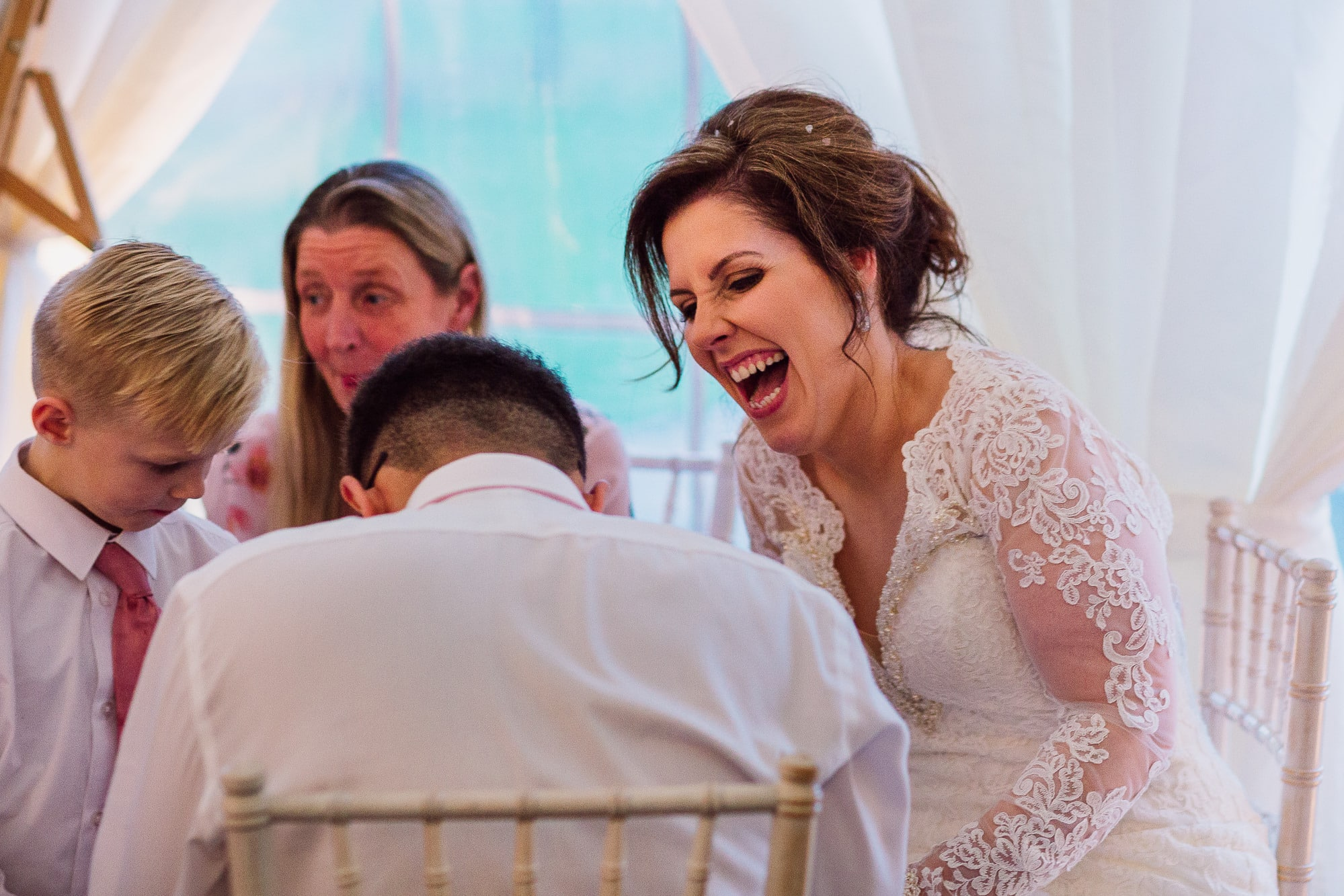 Bride laughing at the wedding breakfast