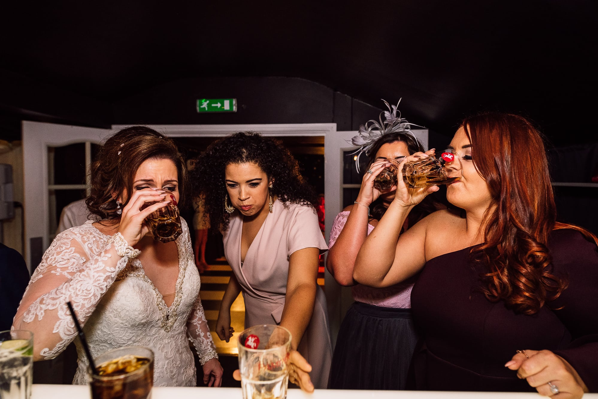 Bride and guests drinking shots