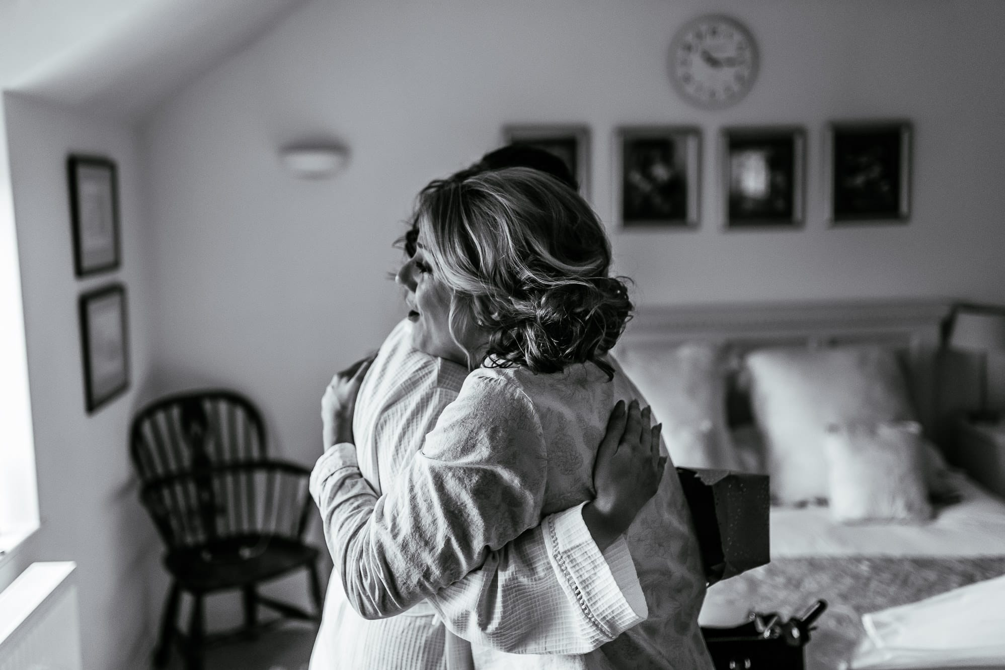 Bride hugging her bridesmaid at Hilltop Country House