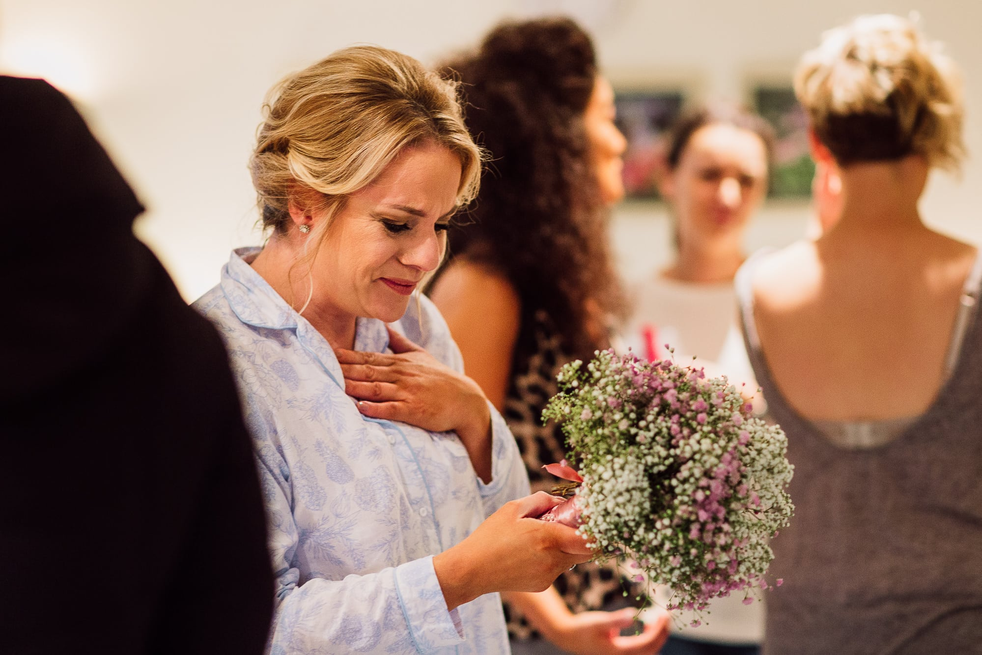 Bridesmaid crying at the flowers