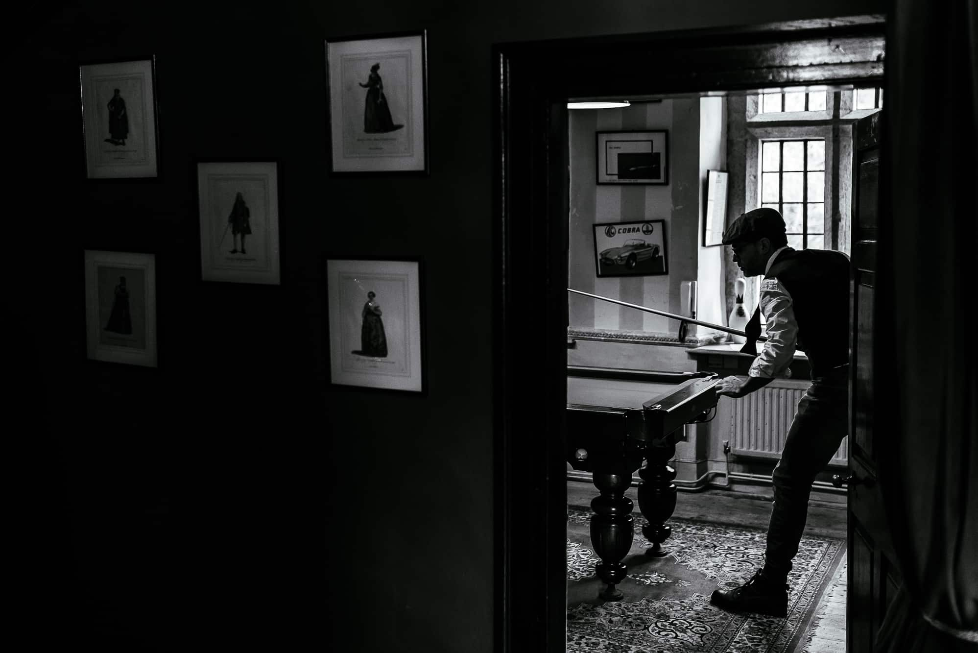 Guest playing pool at Trevor Hall