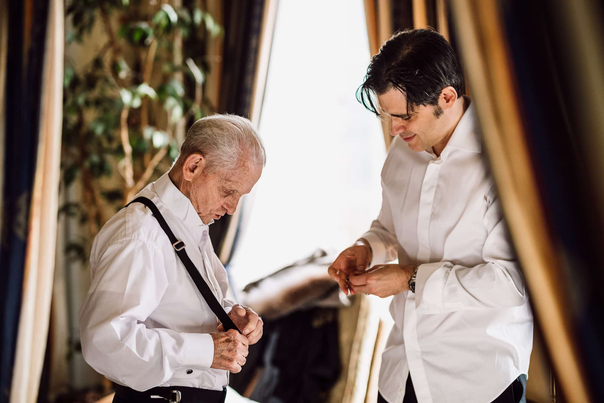 Groom and his dad getting dressed