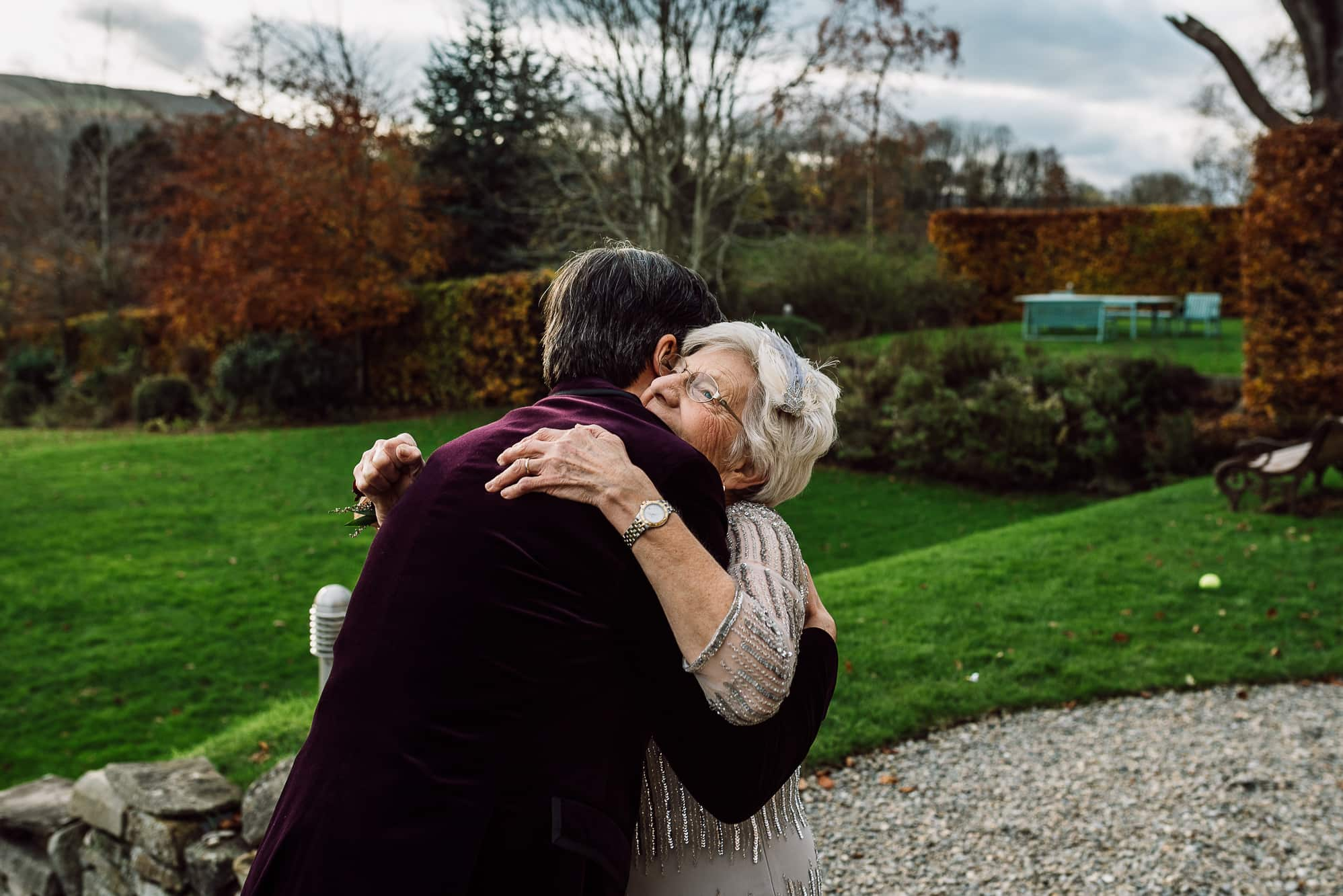 Groom hugging his mum