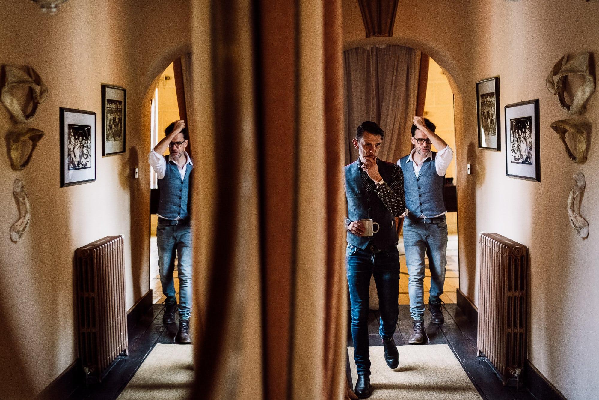 Two best men walking down corridor at Trevor Hall