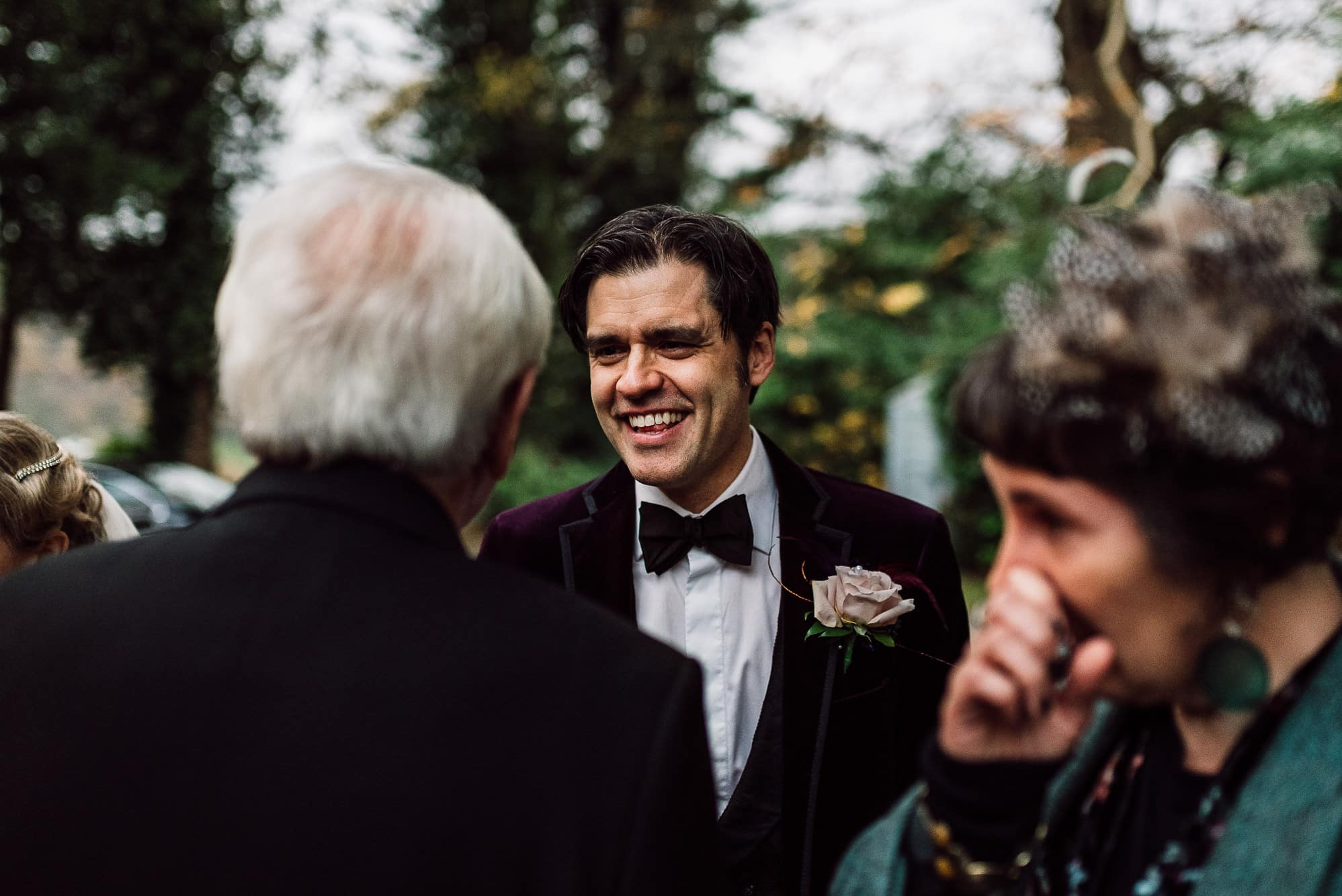 Groom with his guests and one guest is crying at Trevor Hall Church