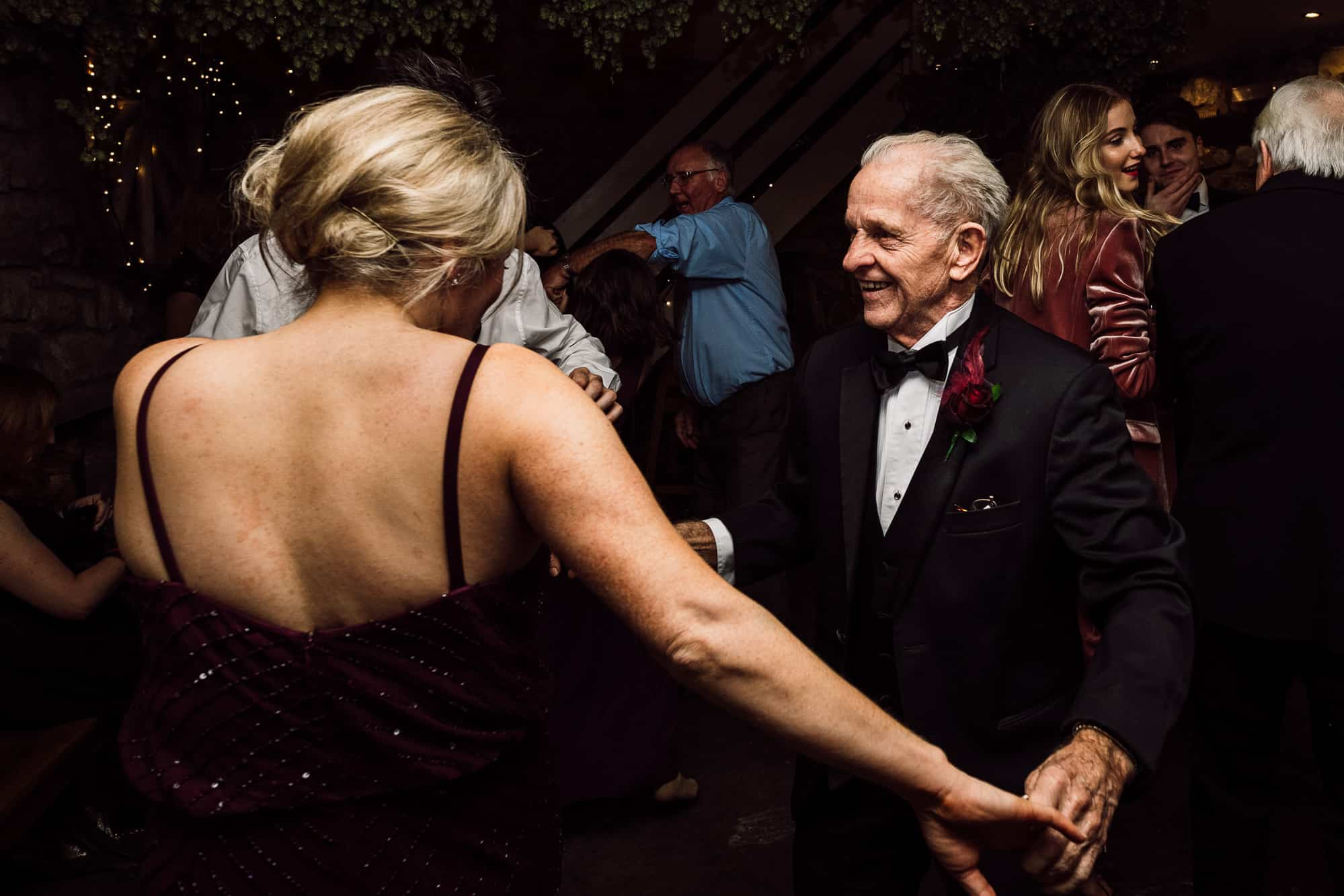Father of the groom and bridesmaid dancing at Tower Hill Barns