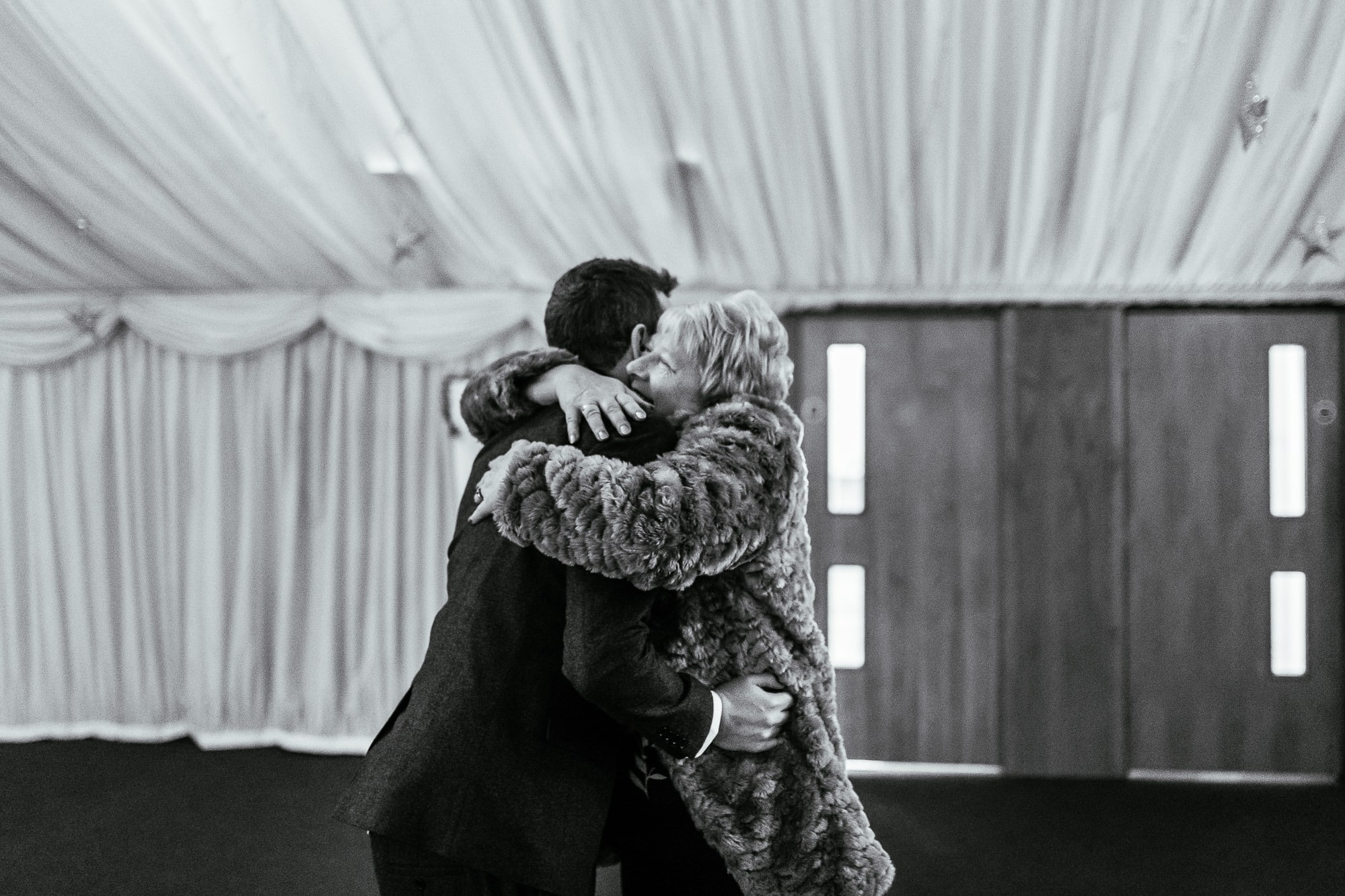 Groom hugging his mum at Heaton House Farm