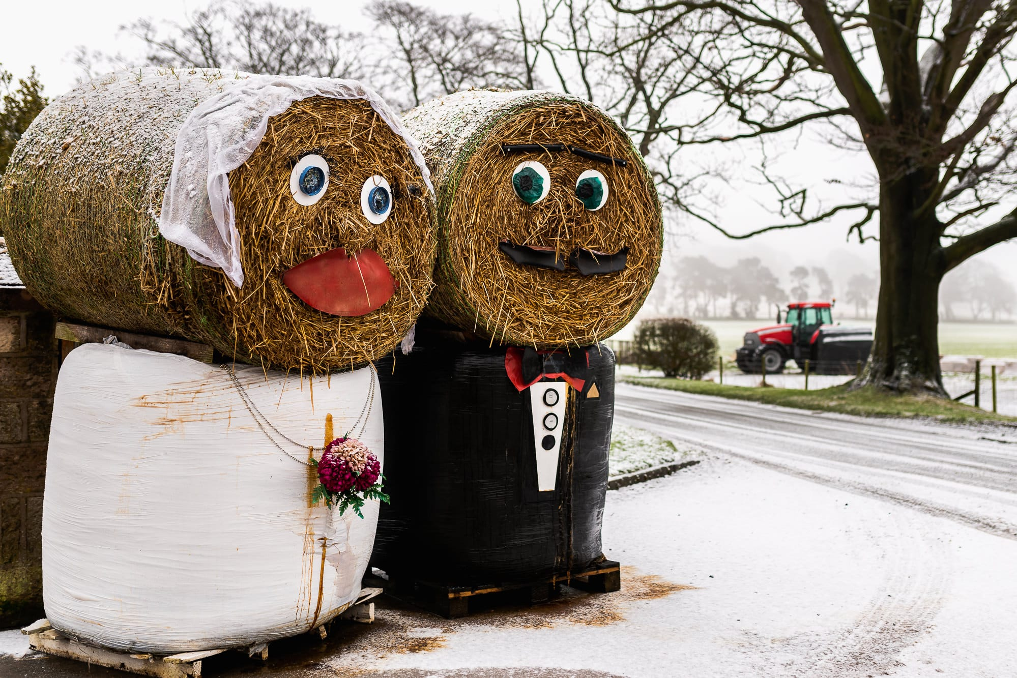 A photo of the bride and groom hay bales at Heaton House Farm